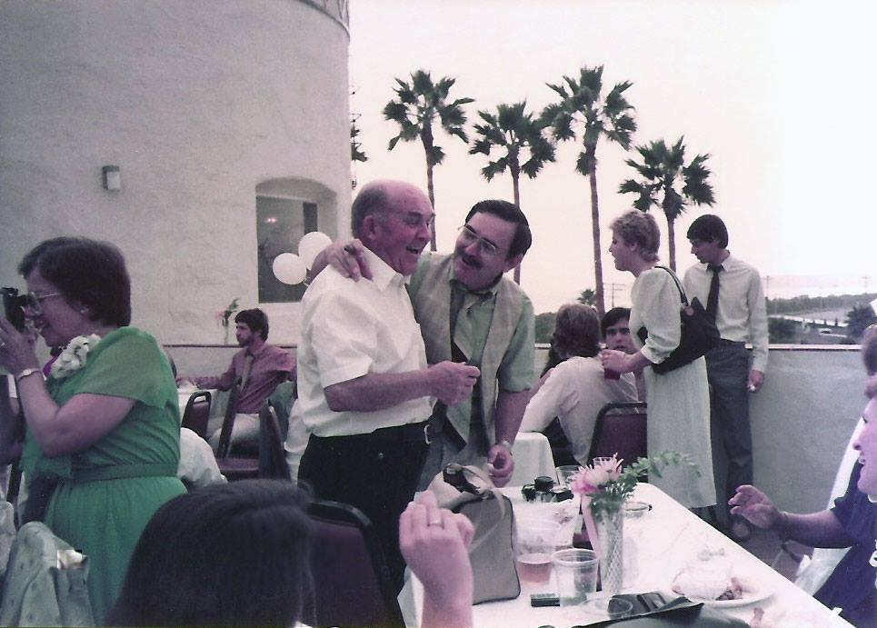 Donald MacLeod, who spent his life in Buffalo, shares a joke with his son Murdo at a family wedding in California, 1980s. (Scott MacLeod/submitted image)