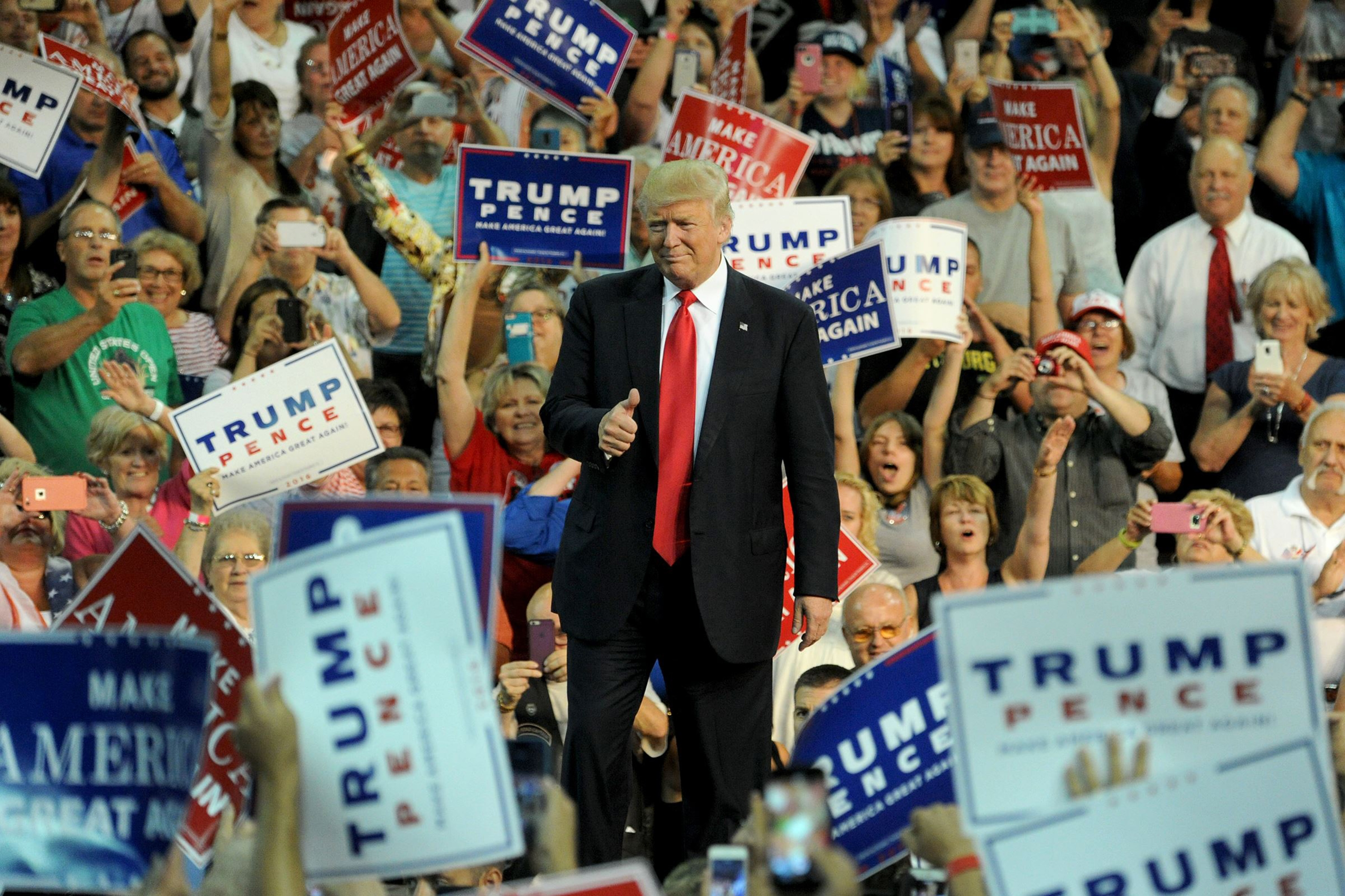 Republican presidential candidate Donald Trump acknowledges supporters while taking the stage during a campaign rally at Erie Insurance Arena in Erie, Pa., on Friday.