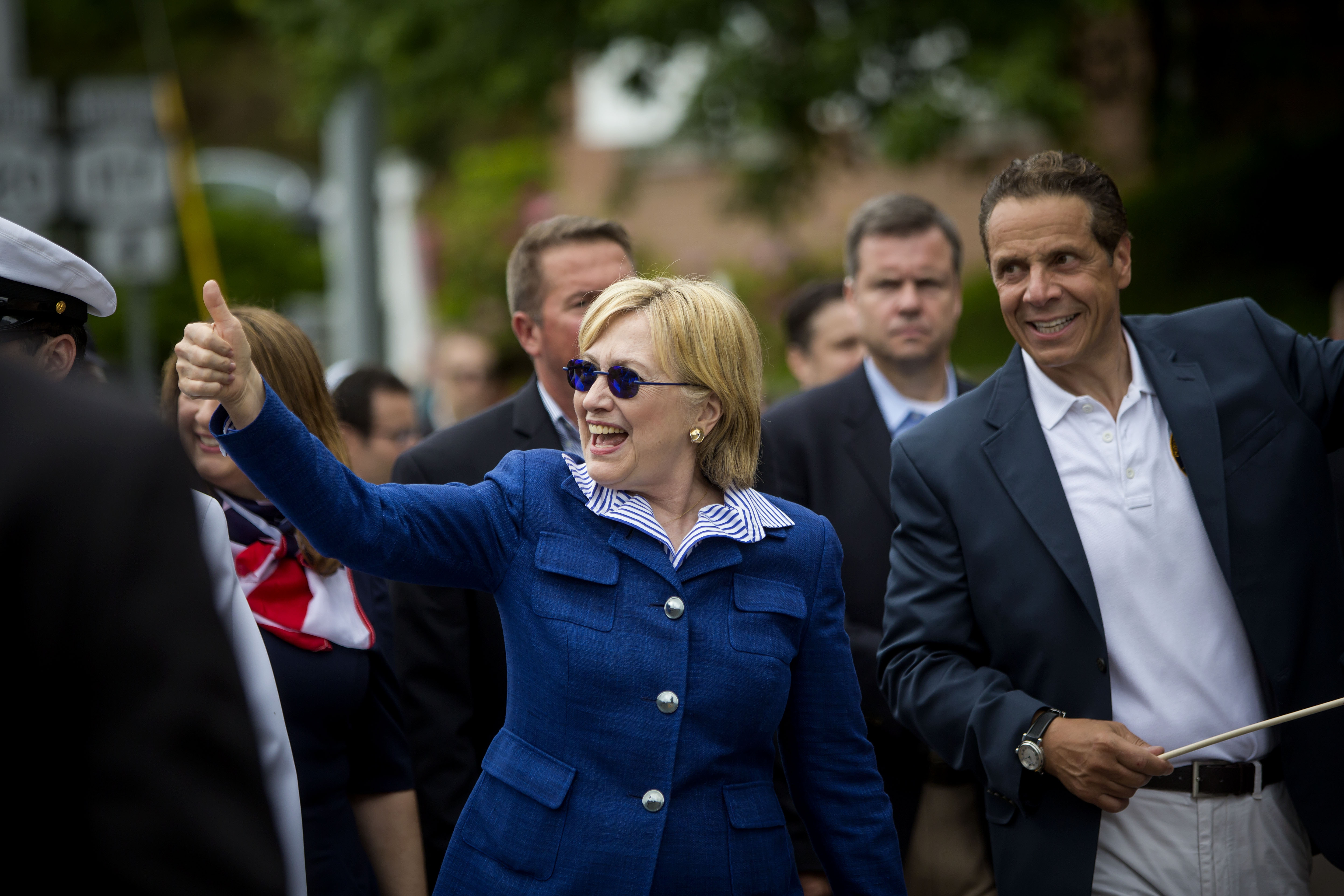 Democratic presidential candidate former Secretary of State Hillary Clinton and New York Governor Andrew M. Cuomo walk in the Memorial Day parade May 30, 2016 in Chappaqua, N.Y. (Getty Images)