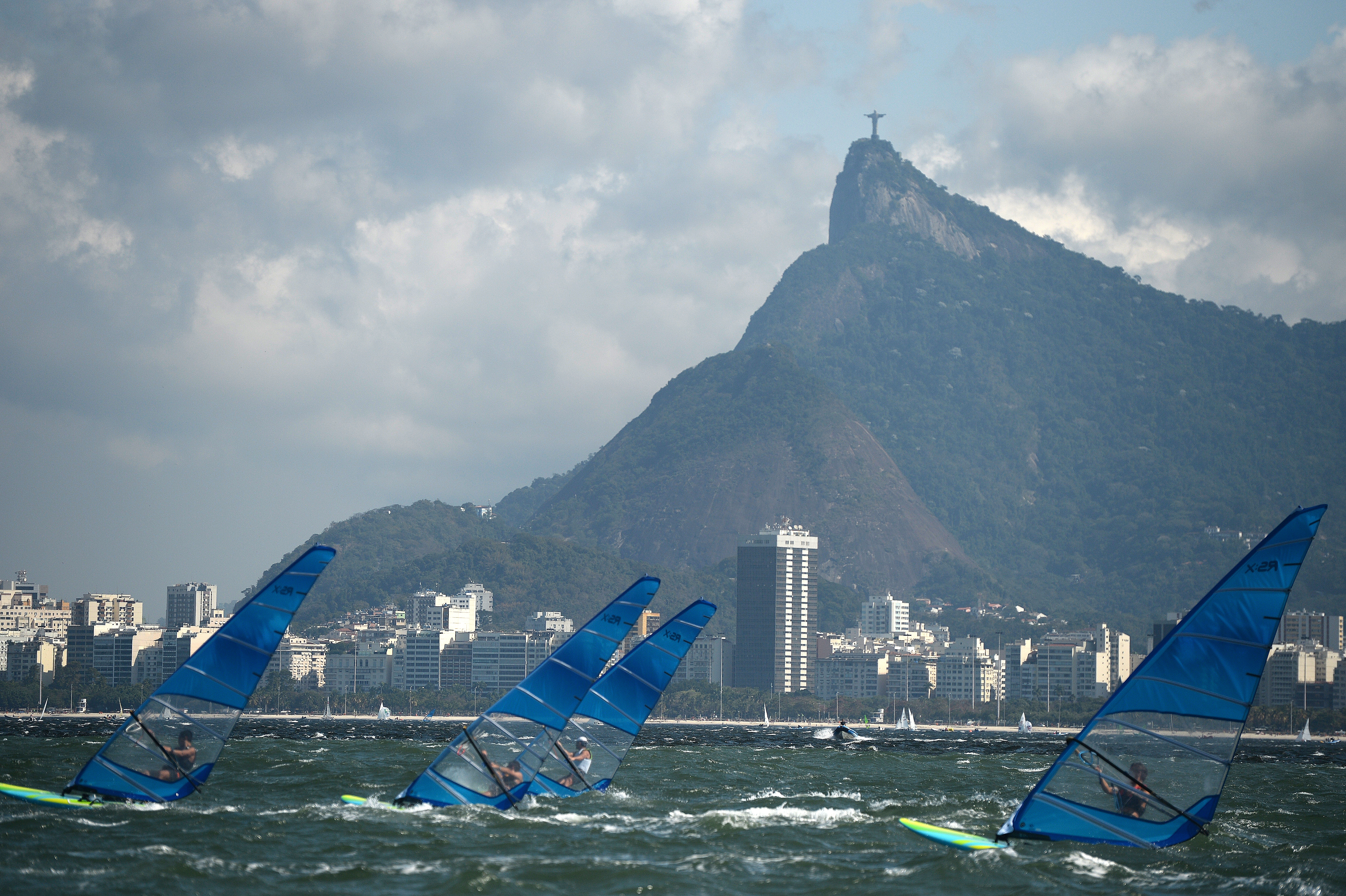 Olympic windsurfers practice at Guanabara Bay, where pollution has raised significant concerns about the health of the swimmers and sailors at the Rio Olympics.