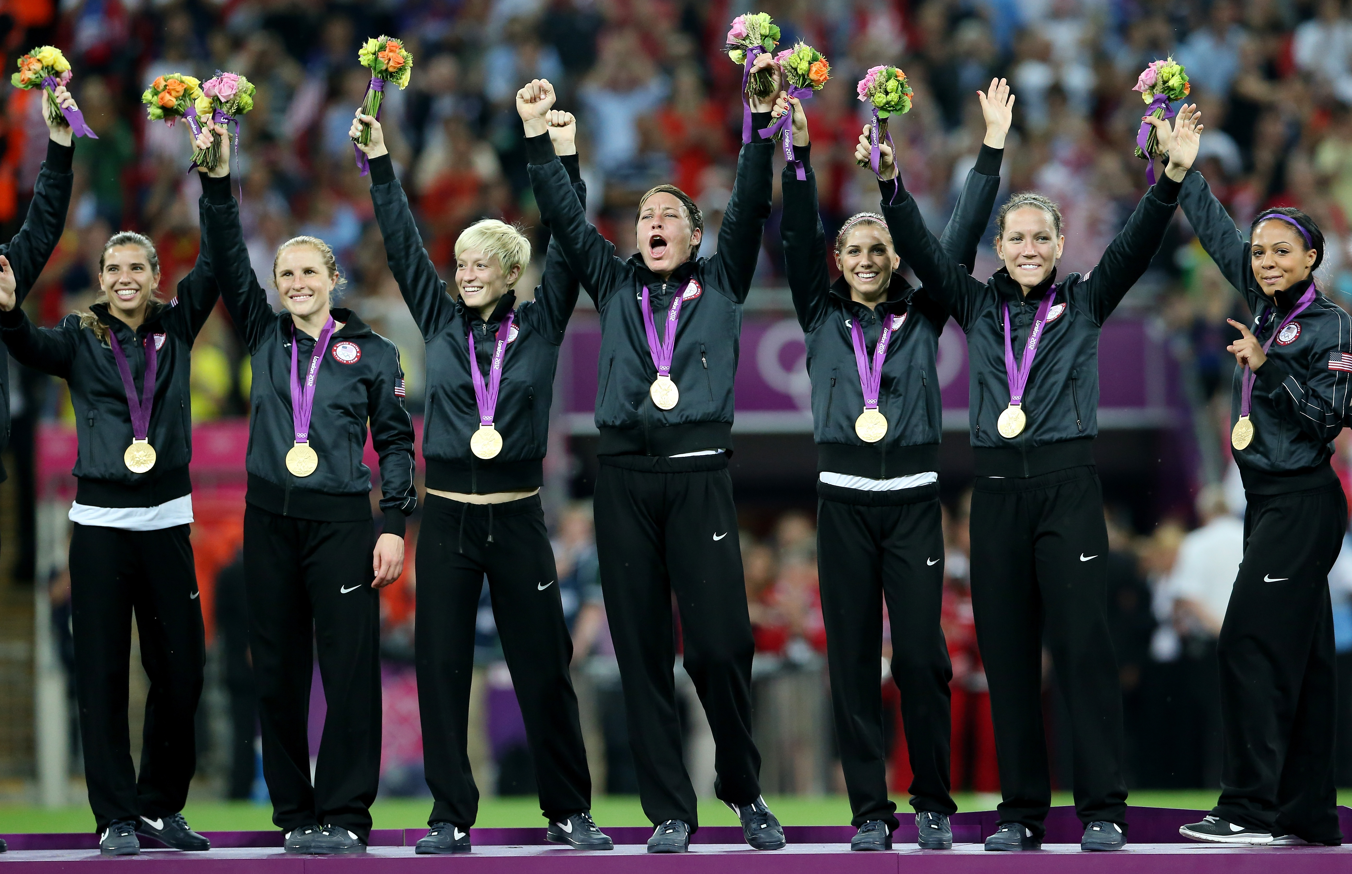 The United States women's soccer team celebrates after winning gold in London.