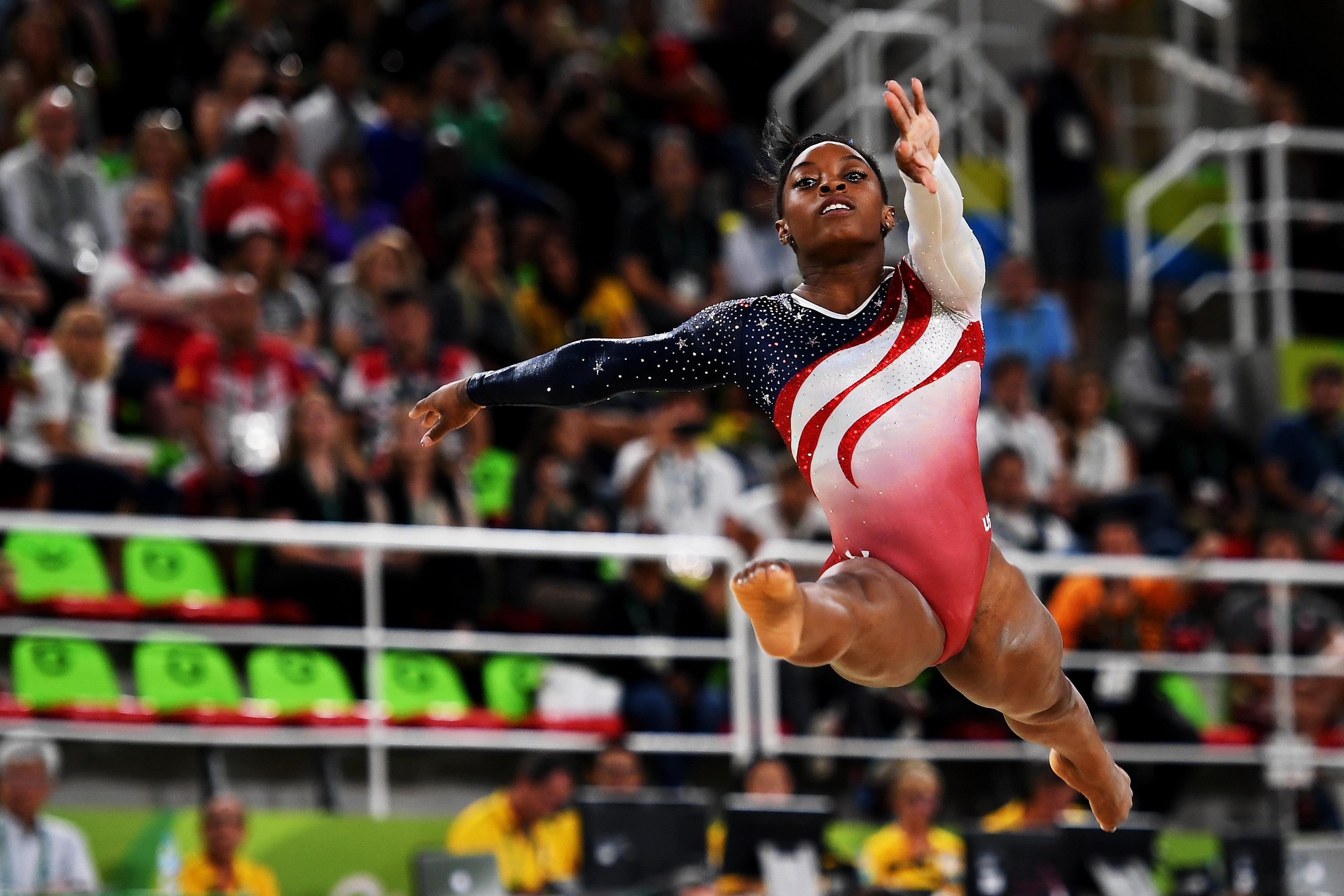 """Gymnastics phenom Simone Biles competes in the floor exercise, where she earned a 15.80 score after the U.S. had clinched gold. """"Yes, I was having fun out there,"""" she said."""