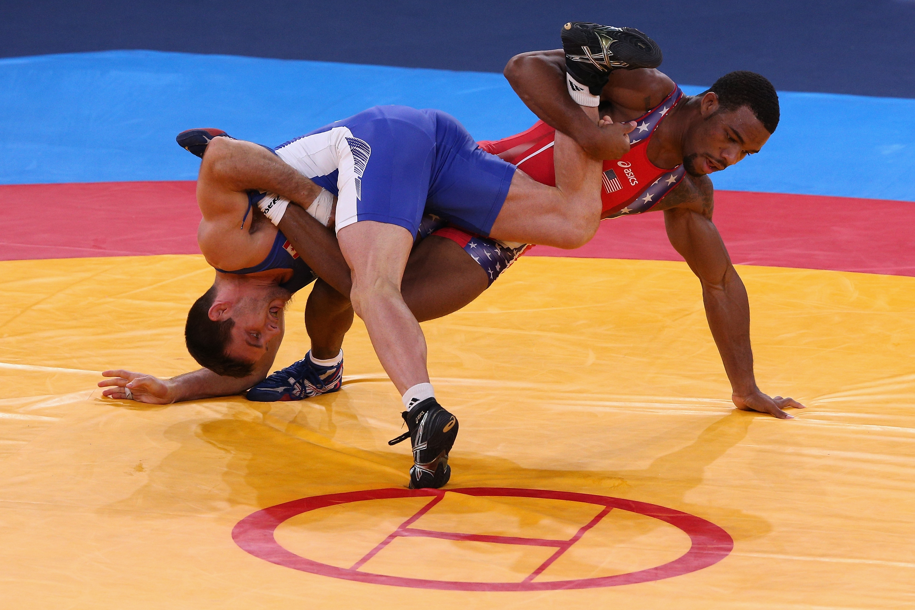Jordan Burroughs of the United States, right, won the gold medal in the 74 kg class in the 2012 London Olympic Games.