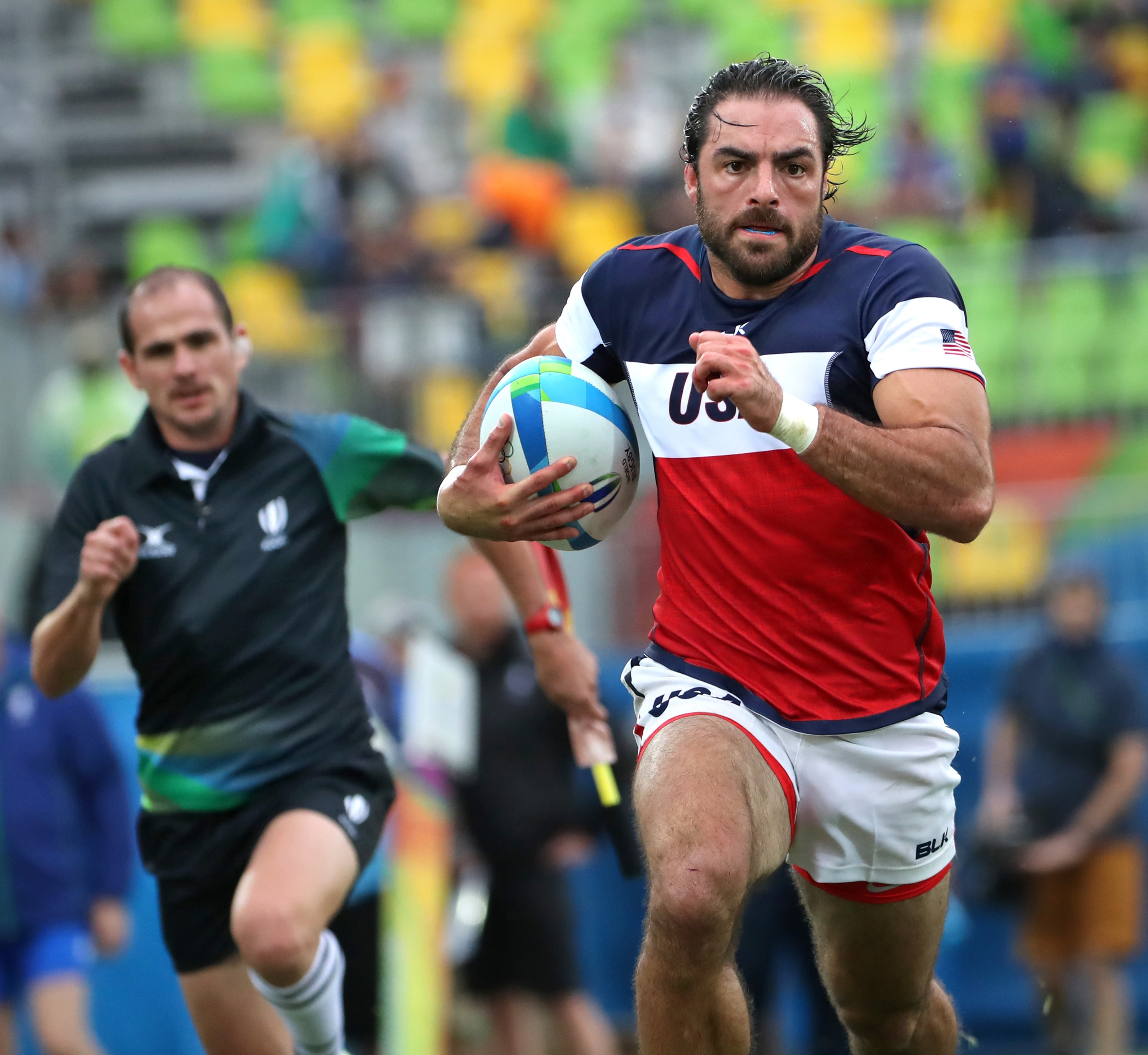 U.S. player Nate Ebner scores a try against Fiji in their rugby match on Wednesday. Rugby is one of the sports benefiting from its worldwide exposure at the Rio Summer Games. (Tribune News Service)