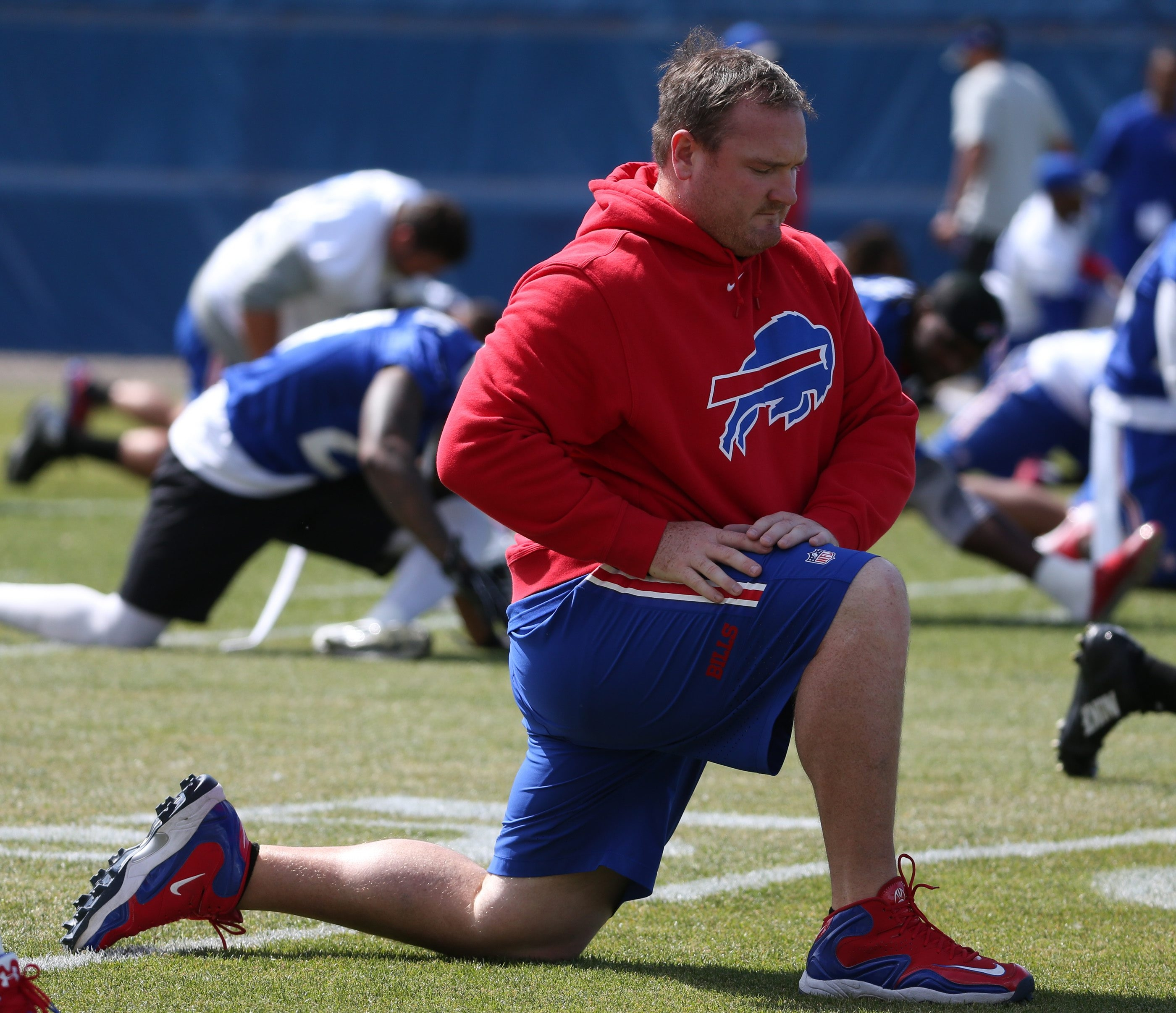 Buffalo Bills defensive tackle Kyle Williams stretches during Bills mandatory minicamp.