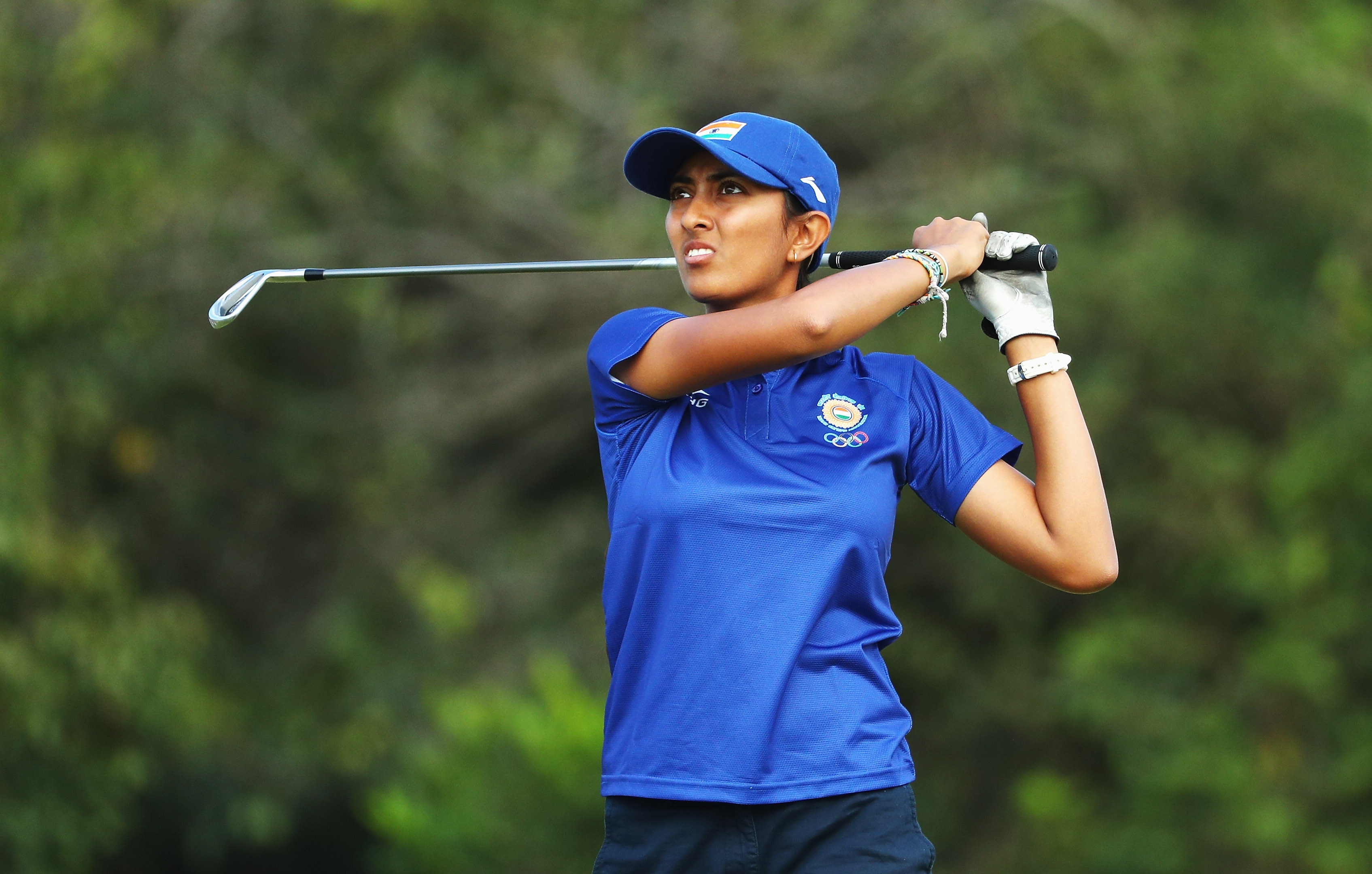 Aditi Ashok of India watches her tee shot on the fourth hole during the second round of women's golf at the Rio Olympics.