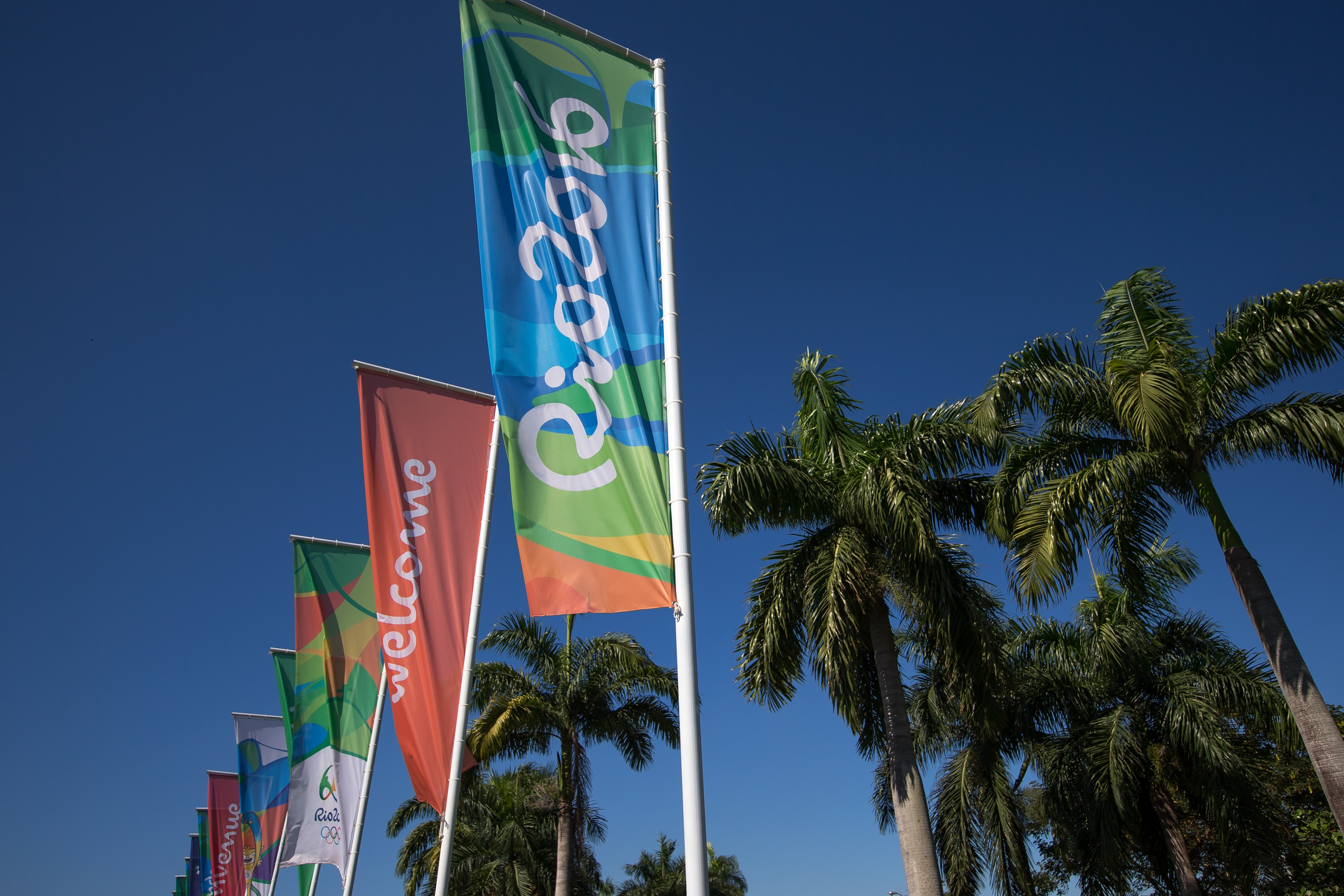 Flags with the logo of Rio 2016 Olympic and Paralympic Games, among others, read 'Welcome' in different languages.