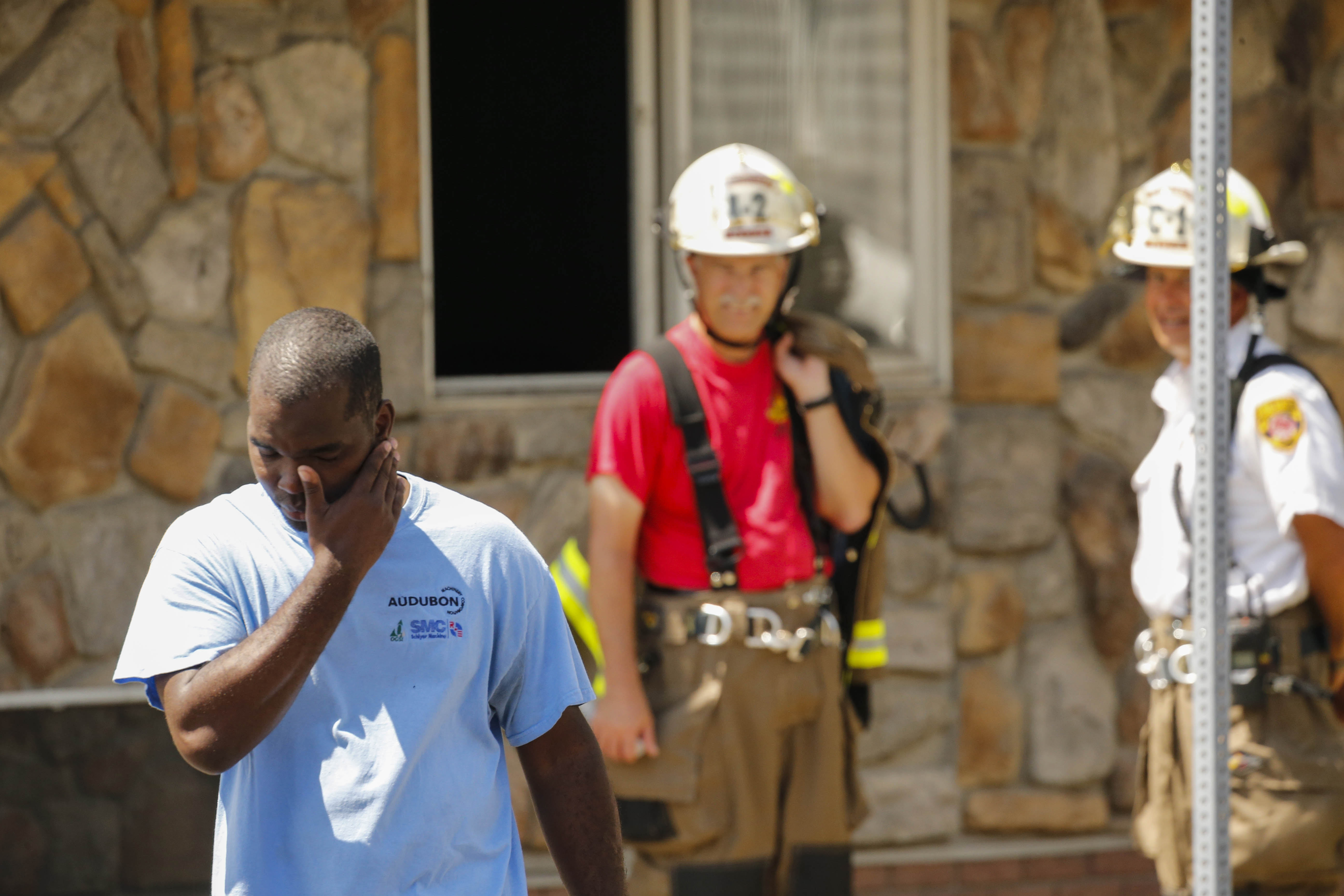Kenneth Walker reacts as North Tonawanda Police and Fire officials investigate the scene of a fire that occurred in his home at Oliver and Felton, Wednesday, Aug. 3, 2016.  Walker recently received a threatening letter asking him to leave the Gratwick Hose fire department where he is the only black member.  (Photo by Derek Gee)