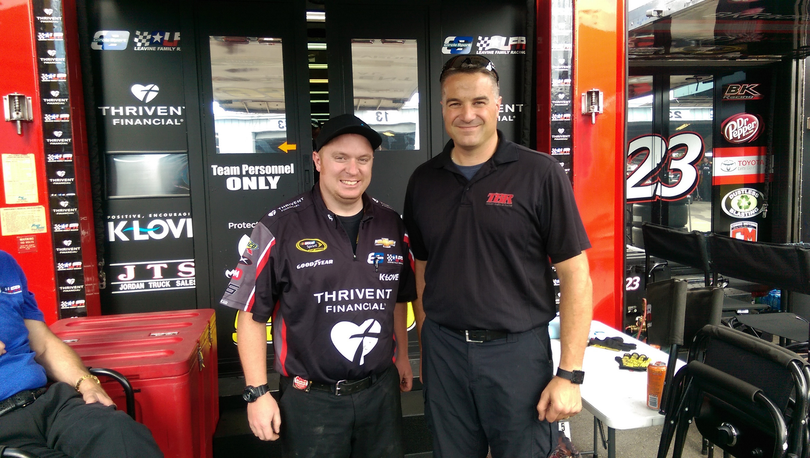 Kevin Walter, left, an engineer for Michael McDowell's race car, stands with his cousin Chad Walter, a crew chief for Regan Smith.