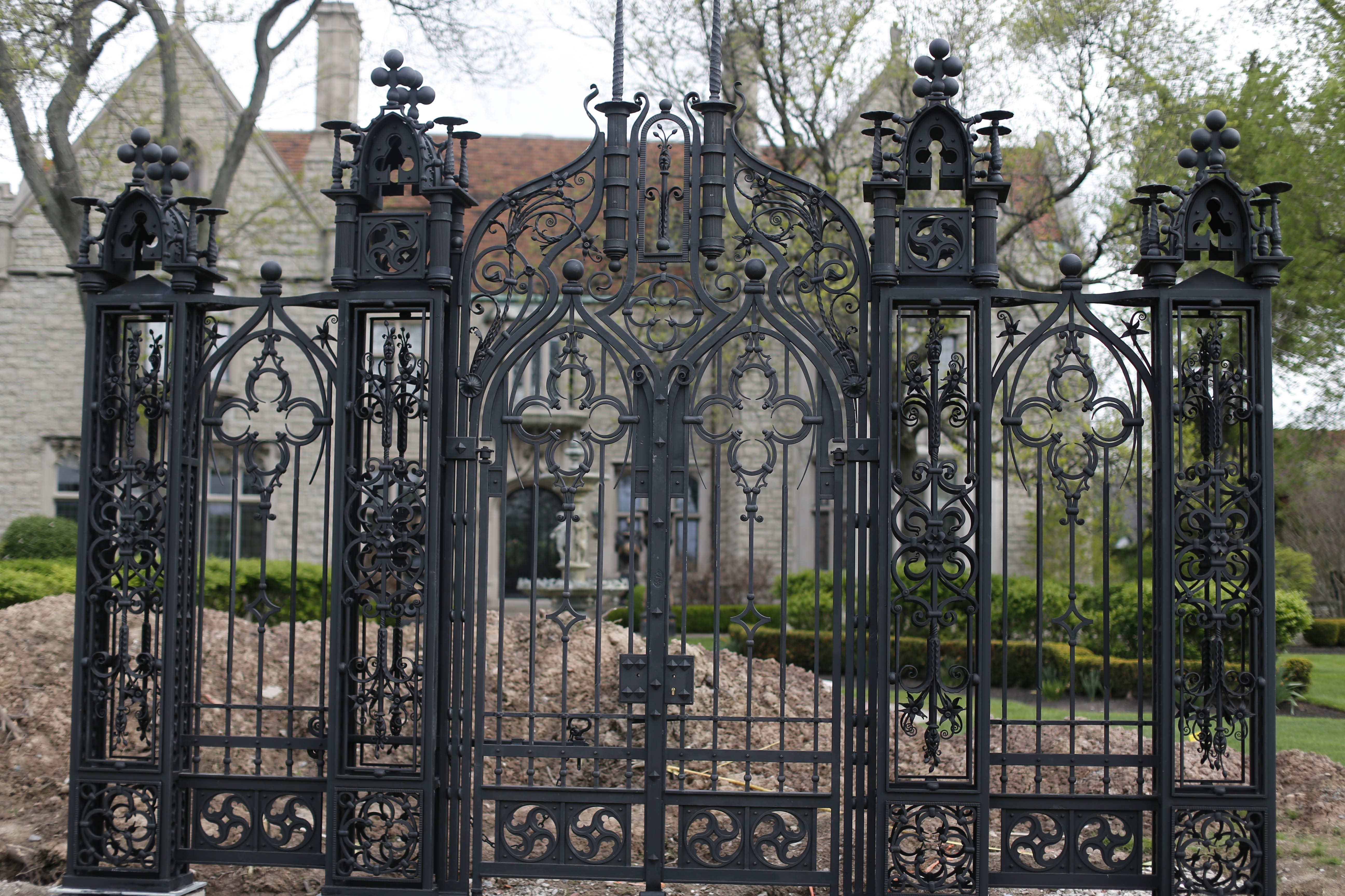 A large wrought-iron gate now stands at the perimeter of the Miller Mansion on Nottingham Terrace.  (Derek Gee/Buffalo News file photo)