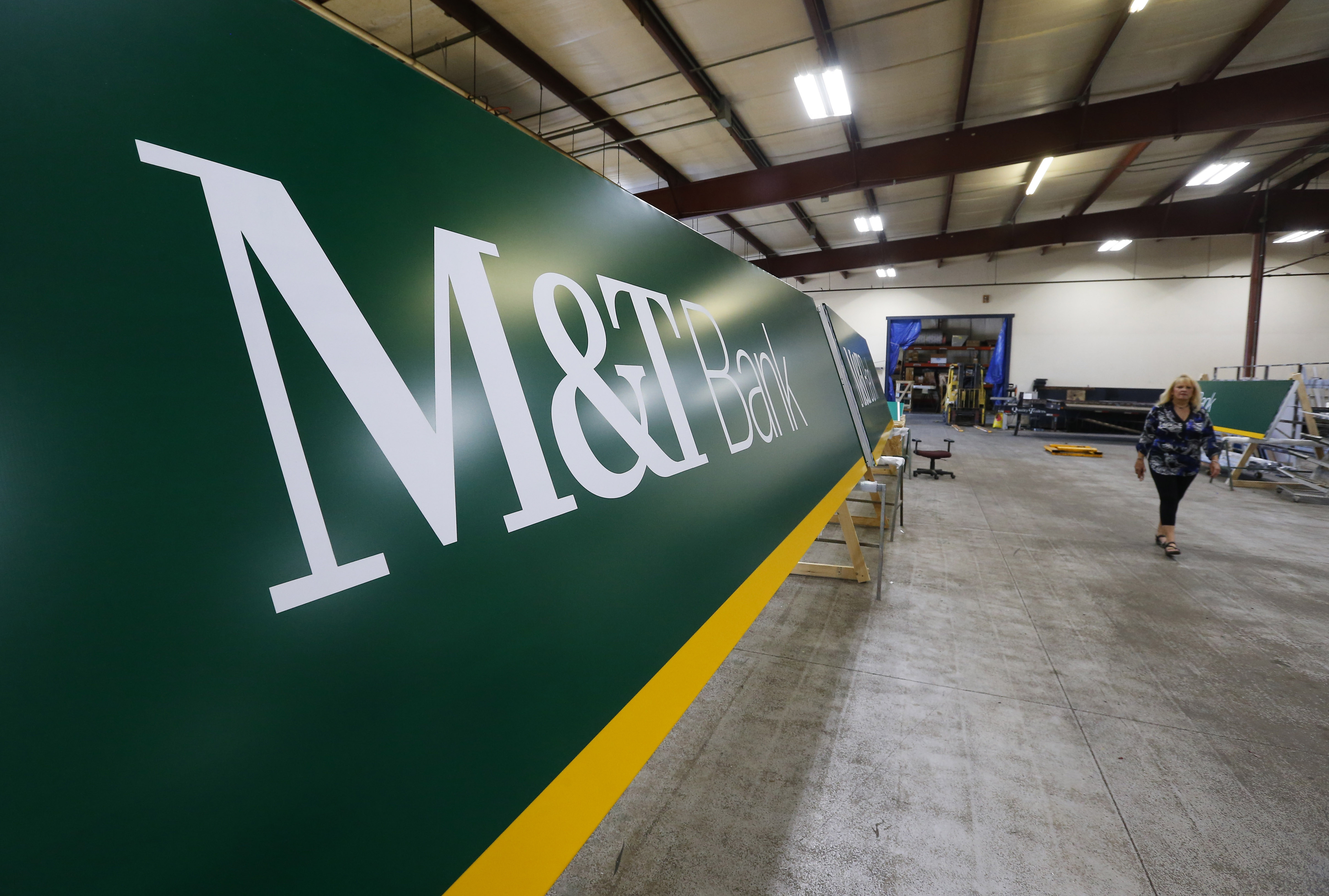 Premier Sign Systems is making new signage that will be used at M&T Bank branches outside of Western New York. Premier is manufacturing the signs in its Rochester workshop, shown here on Aug. 3.