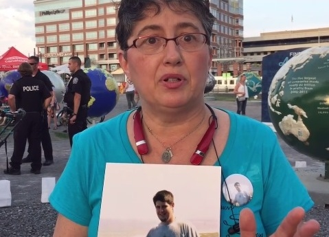 A parent speaks at a vigil for opioid victims. (Buffalo News)