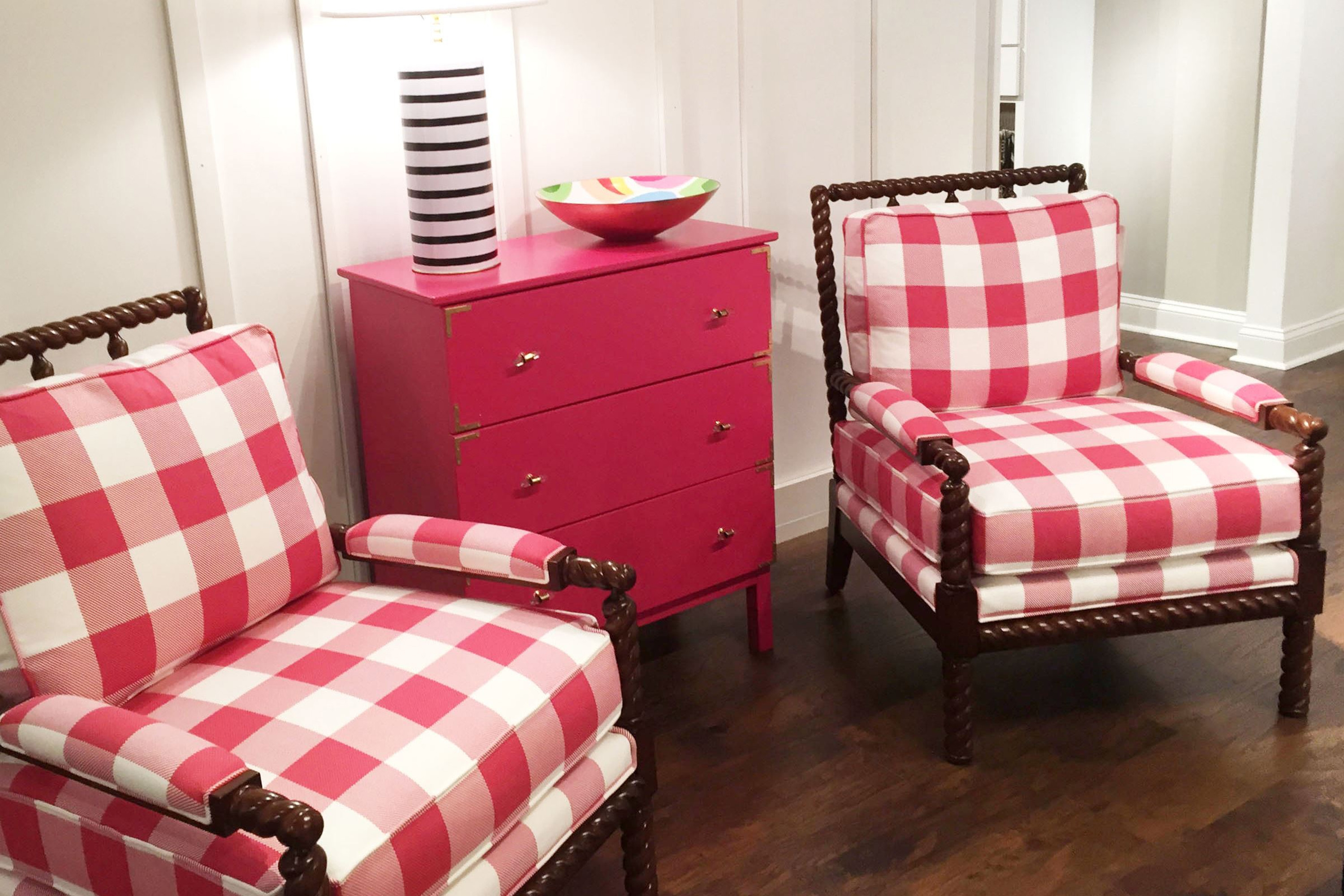 Designer Dana Gibson showed off a bold buffalo check in raspberry on Parthie spindle-framed chairs for MT Company.