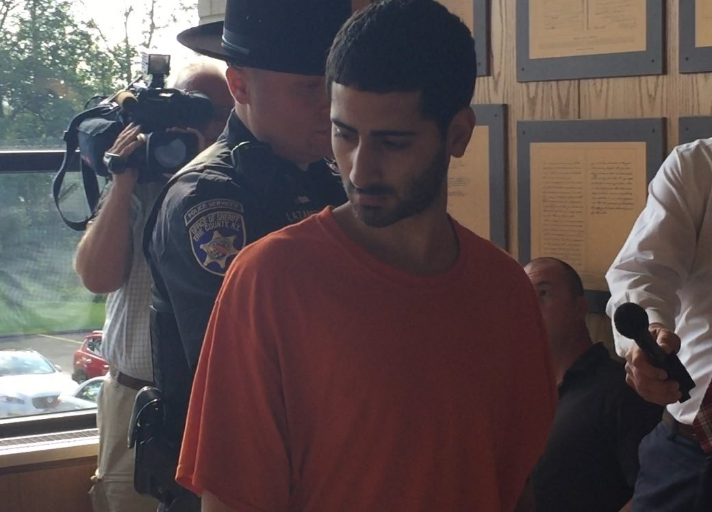 Sammy Abdellatif is escorted into Grand Island Town Court Friday morning. (Aaron Besecker/Buffalo News)