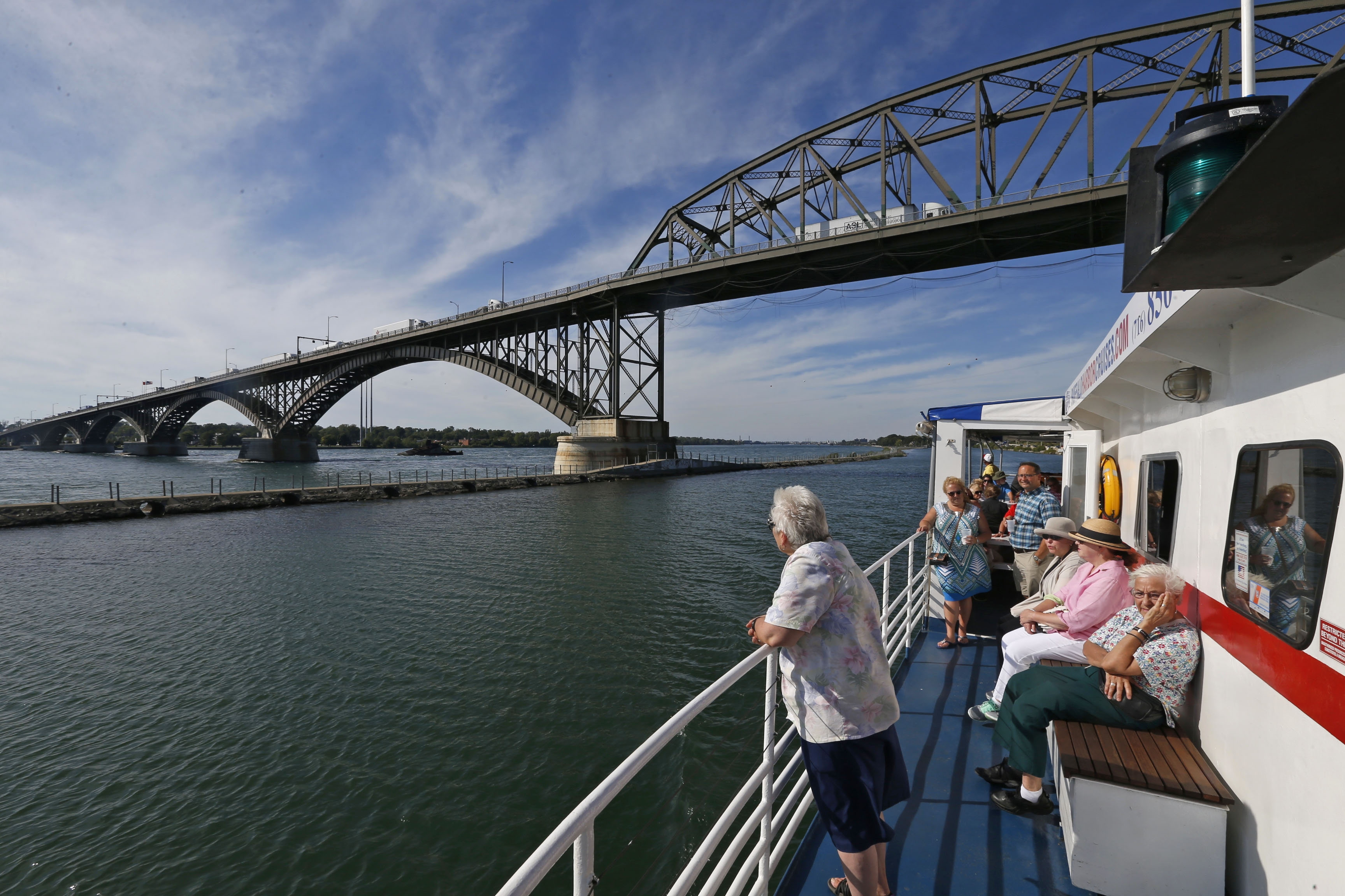Aboard the Miss Buffalo: The Peace Bridge soars majestically overhead as the Miss Buffalo, piloted by Capt. Tom Woodrow, plies the Niagara River waters. The ship leaves the Erie Basin Marina for a two-hour excursion, which includes a trip through the Black Rock Lock on the way back.