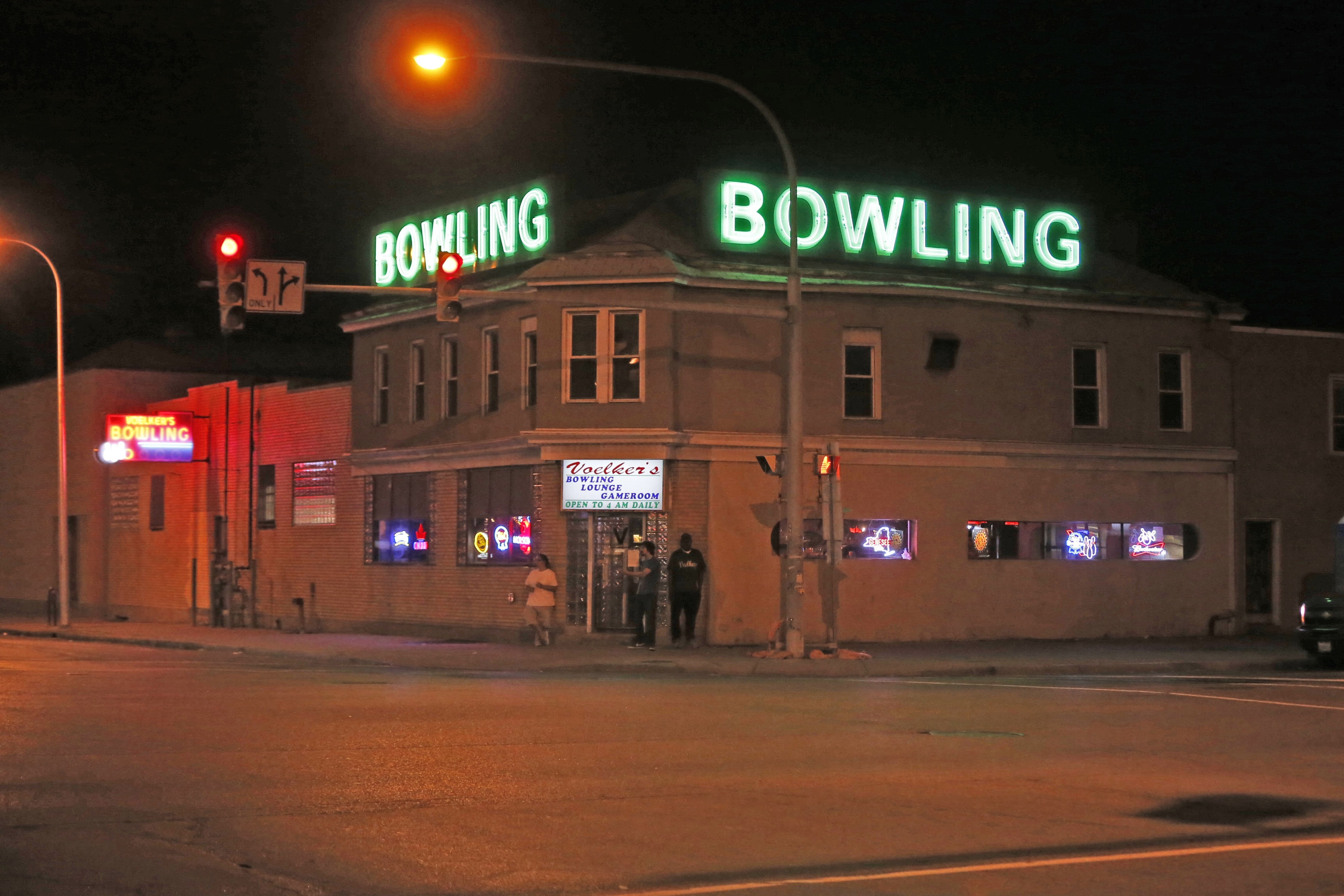 Voelker's Lanes, an Elmwood Avenue landmark is known for its colorful, flashing neon sign, vintage barroom and the sights and sounds of bowling. (Robert Kirkham/Buffalo News)