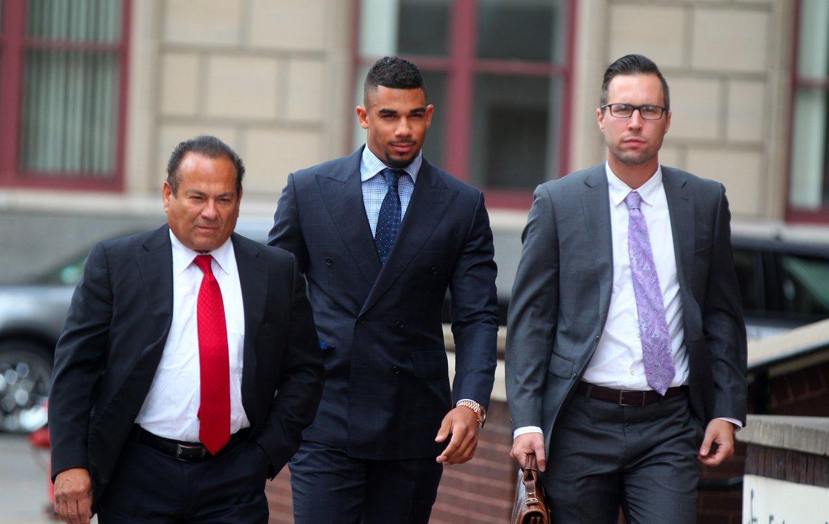 Defense attorney Paul Cambria, left, accompanies Buffalo Sabres' star Evander Kane, center, into Buffalo City Court Monday. (Mark Mulville/Buffalo News)