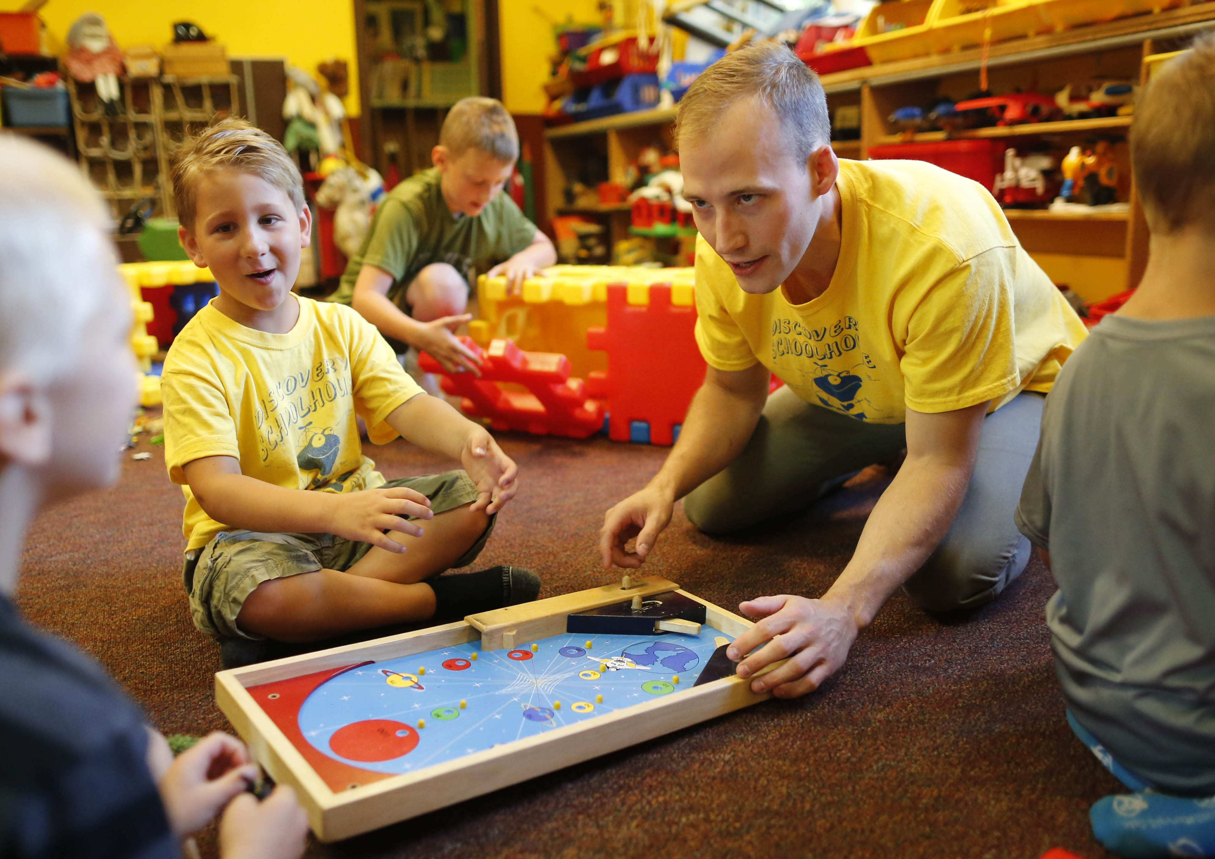John Maher, the new owner of the Discovery Schoolhouse in Hamburg, plays with students during free play, Tuesday, Aug. 2, 2016.  (Photo by Derek Gee)