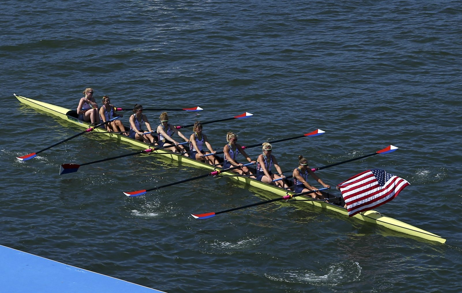 Gold medalists Team USA row away after the medal ceremony in the Women's Eight Finals at Lagoa Stadium August 13, 2016 in Rio De Janeiro, Brazil. (Getty Images)