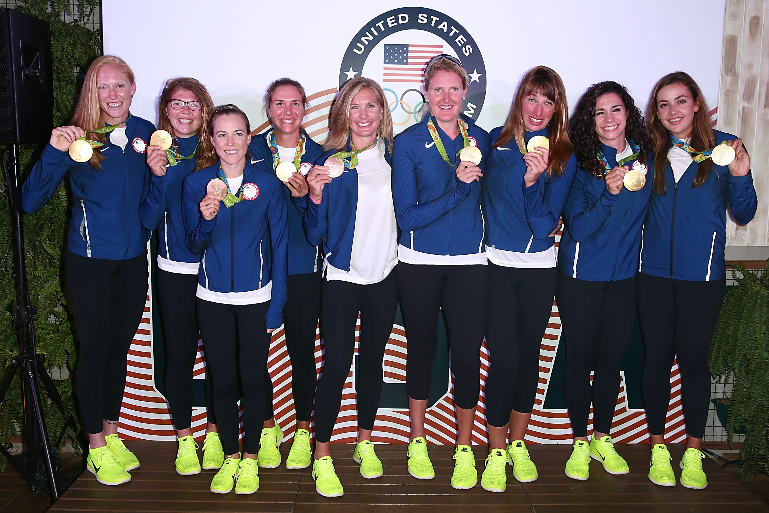 U.S. Olympians Emily Regan, Lauren Schmetterling, Katelin Snyder, Amanda Elmore, Meghan Musnicki, Elle Logan, Tessa Gobo and Kerry Simmonds pose with their gold medals at the USA House at Colegio Sao Paulo in Rio de Janeiro, Brazil.  (Getty Images)