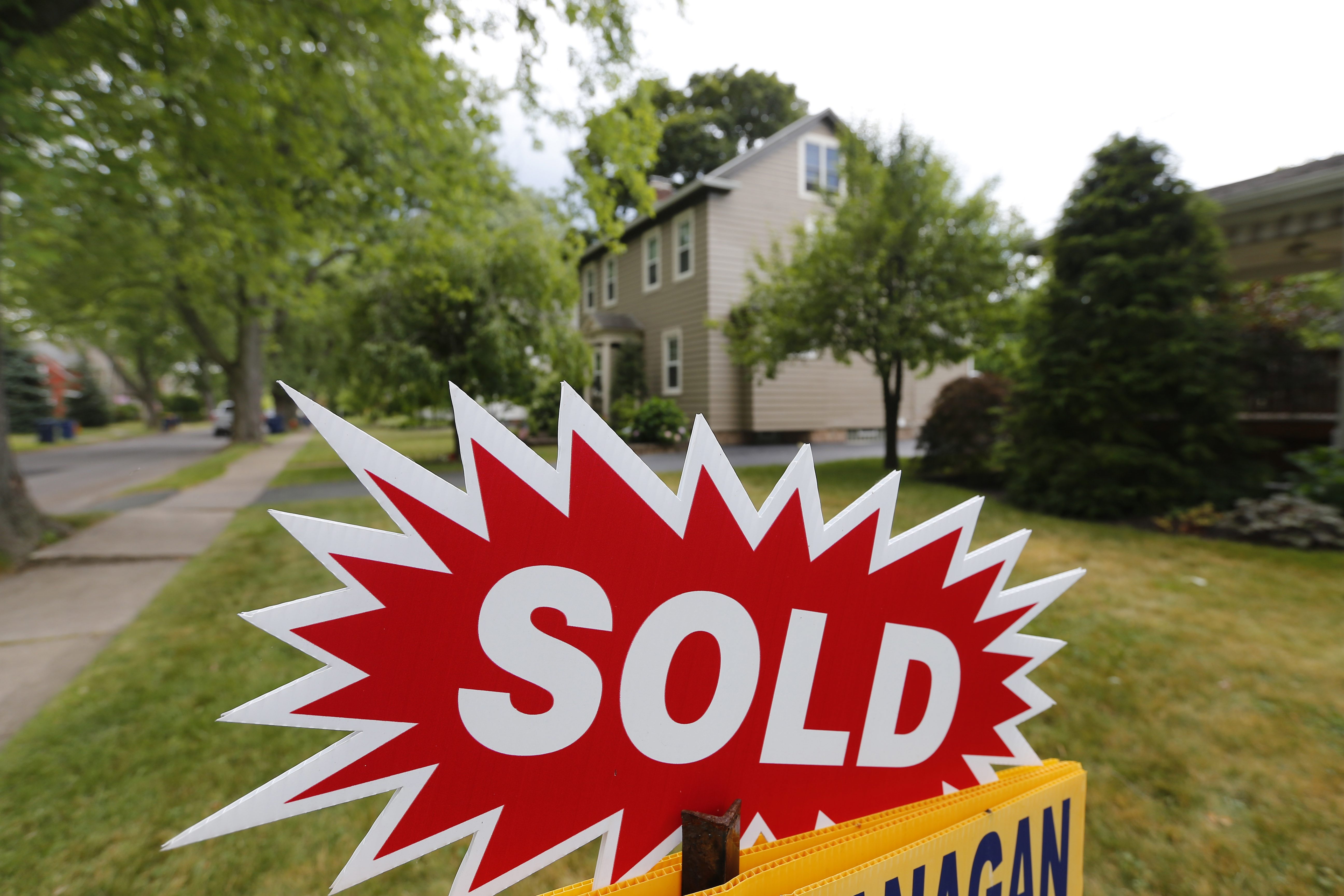 A sold sign sits outside a home on Morrow Street  in Lockport on July 7, 2016.  (Mark Mulville/Buffalo News)