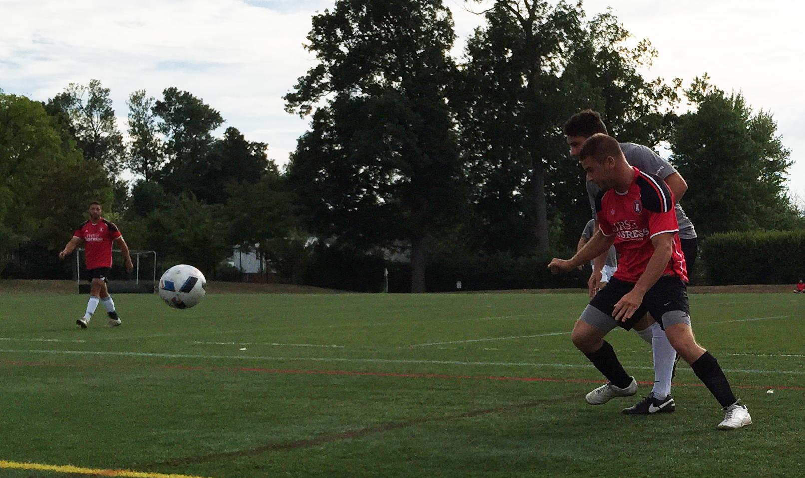 Justin Hofschneider, in red, races after a loose ball in the BDSL premier final. (Ben Tsujimoto/Buffalo News)