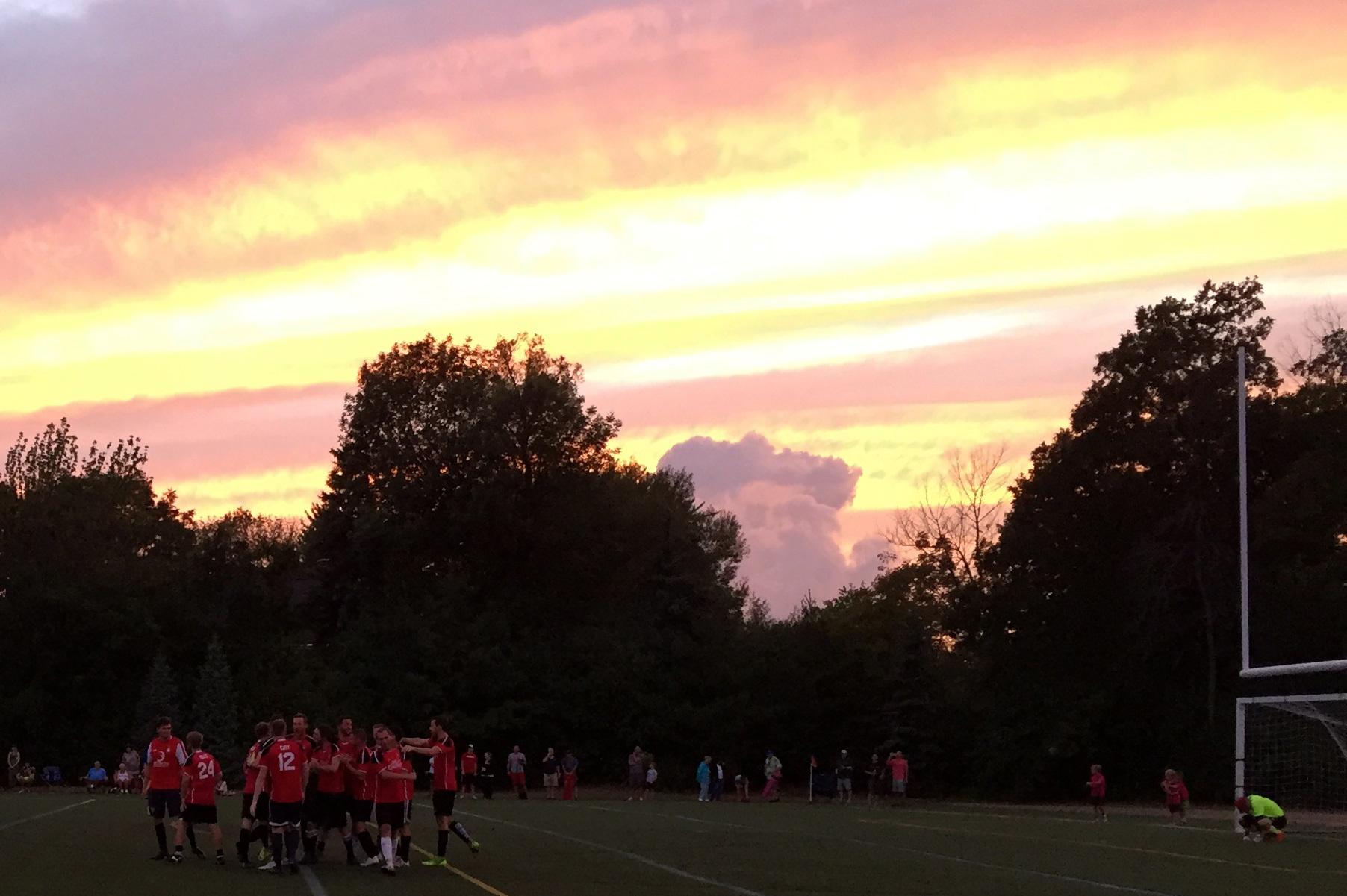 Sharpshooters celebrate their title win as the sun sets. (Ben Tsujimoto/Buffalo News)