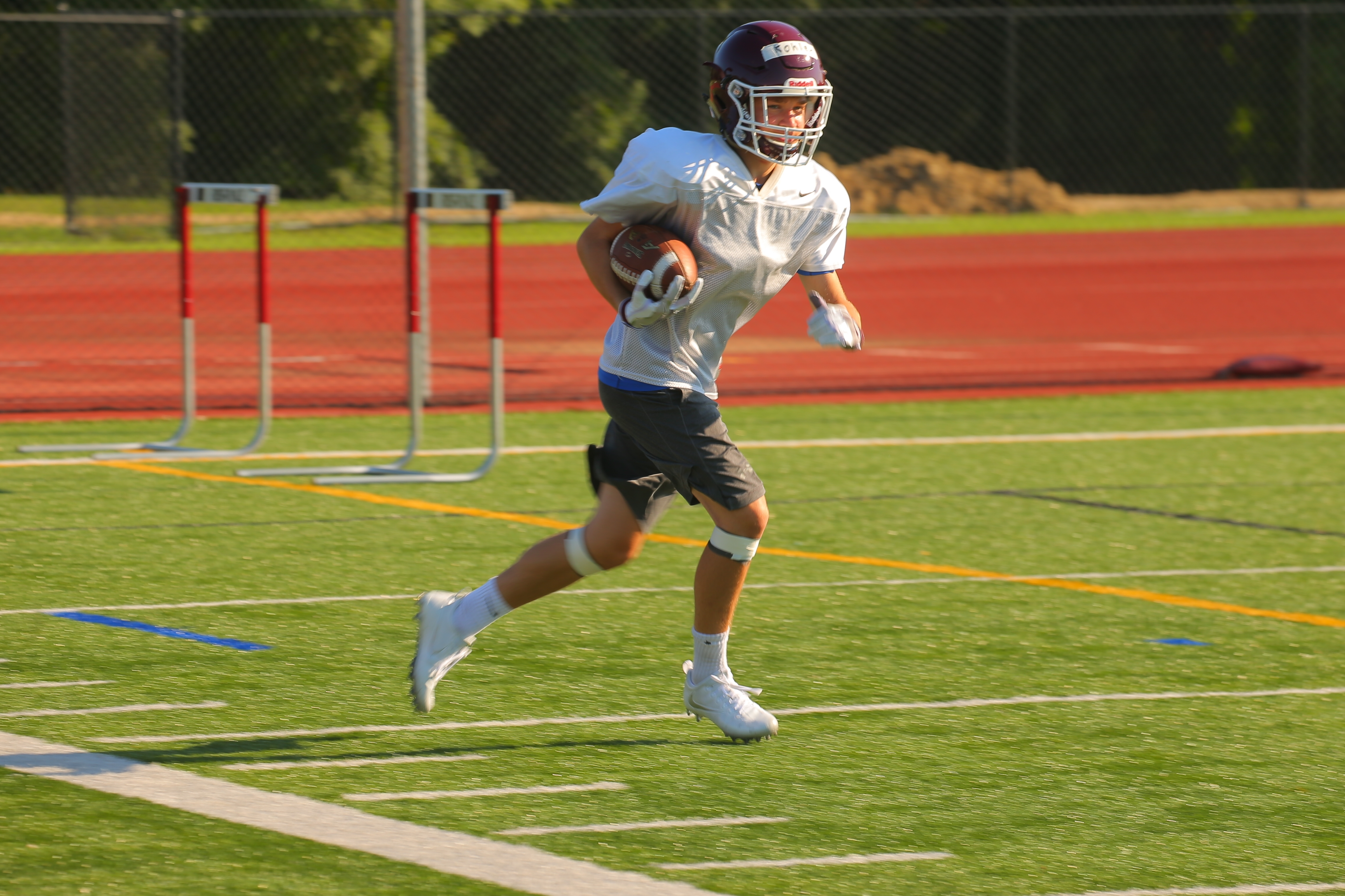 Jacob Kohler carries the ball at practice for the Orchard Park High School varsity football team in Orchard Park, N.Y., on Friday Aug. 19, 2016.  (John Hickey/Buffalo News)