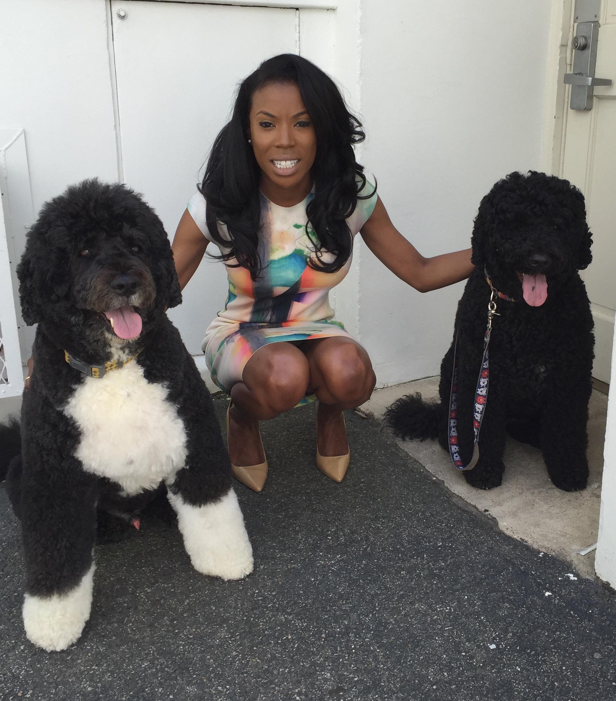 Photo credit: Jerry Zremski/The Buffalo News Cutline for the fourth pic: Desiree Barnes of Amherst finds that one of the fringe benefits of working at the White House is time spent with the Obama family dogs, Bo and Sunny.
