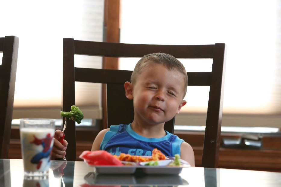 Corey Hickey, 4, of Williamsville, is not a big fan of vegetables but his parents keep encouraging him to try them. (Photos by Sharon Cantillon/Buffalo News)
