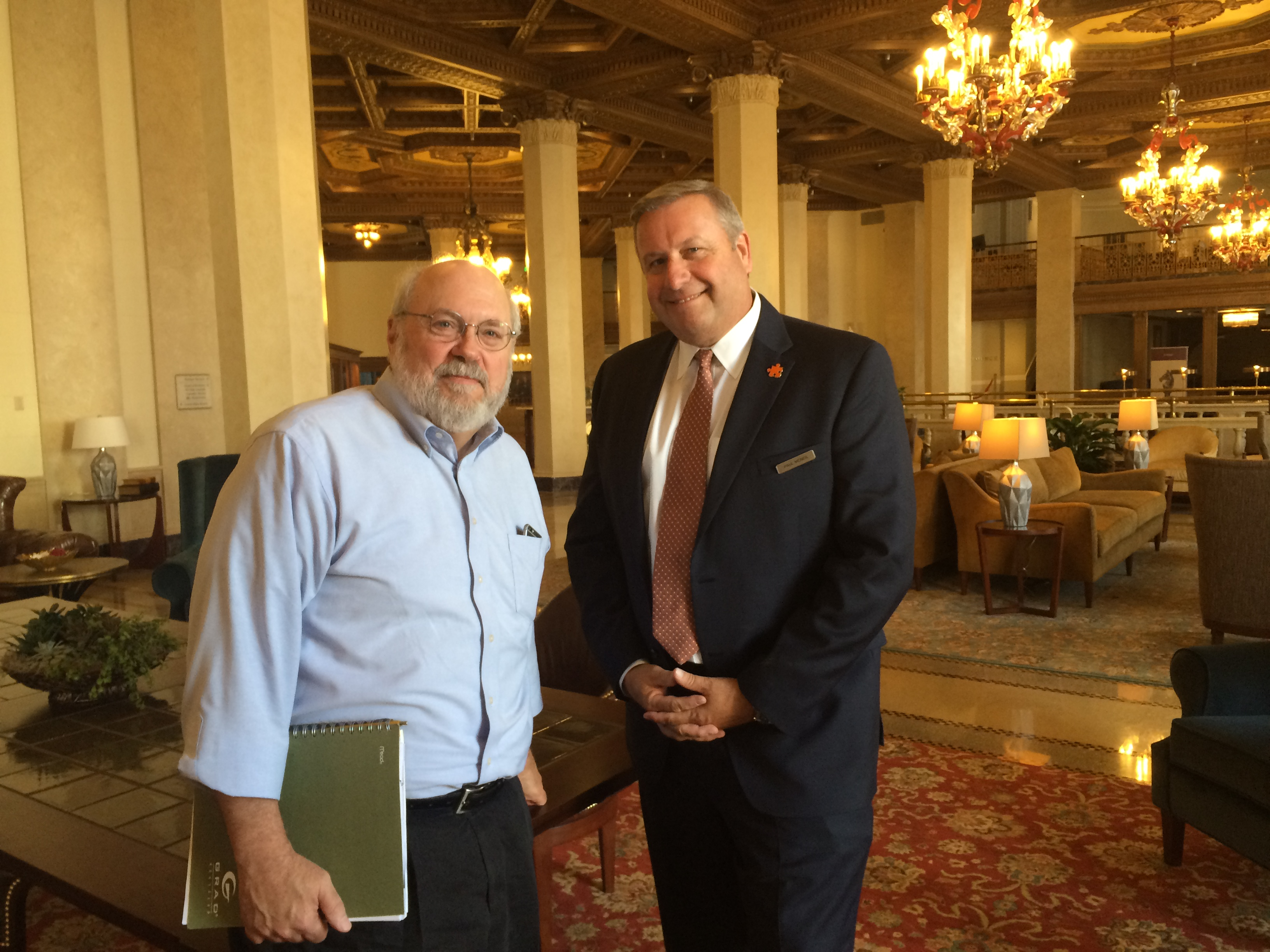 Developer Ed Riley and Paul McNeil, hotel general manager and a Buffalo native, in the lobby of the restored Marriott Syracuse Downtown, traditionally called the  Hotel Syracuse. Riley plans to submit a proposal for restoring the Hotel Niagara. (Sean Kirst/Submitted image)
