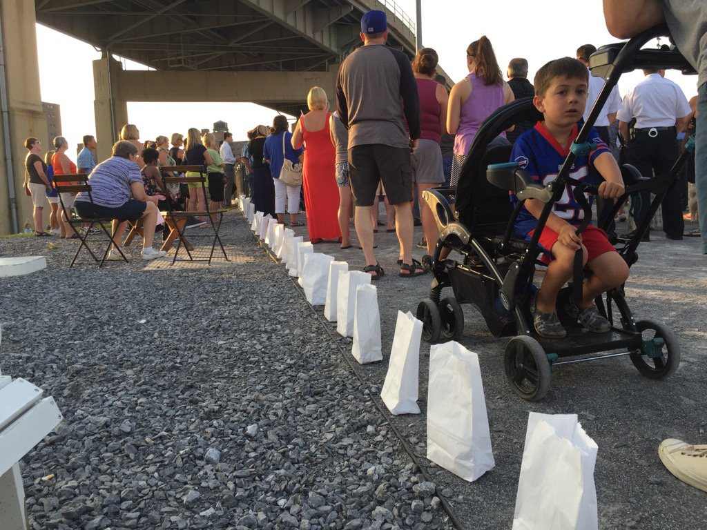 Several dozen people who lost loved ones to heroin and opiate addiction gathered at Canalside last year to mourn and to raise awareness. This year, a candlelight memorial event was held at LaSalle Park. (Maki Becker/Buffalo News)