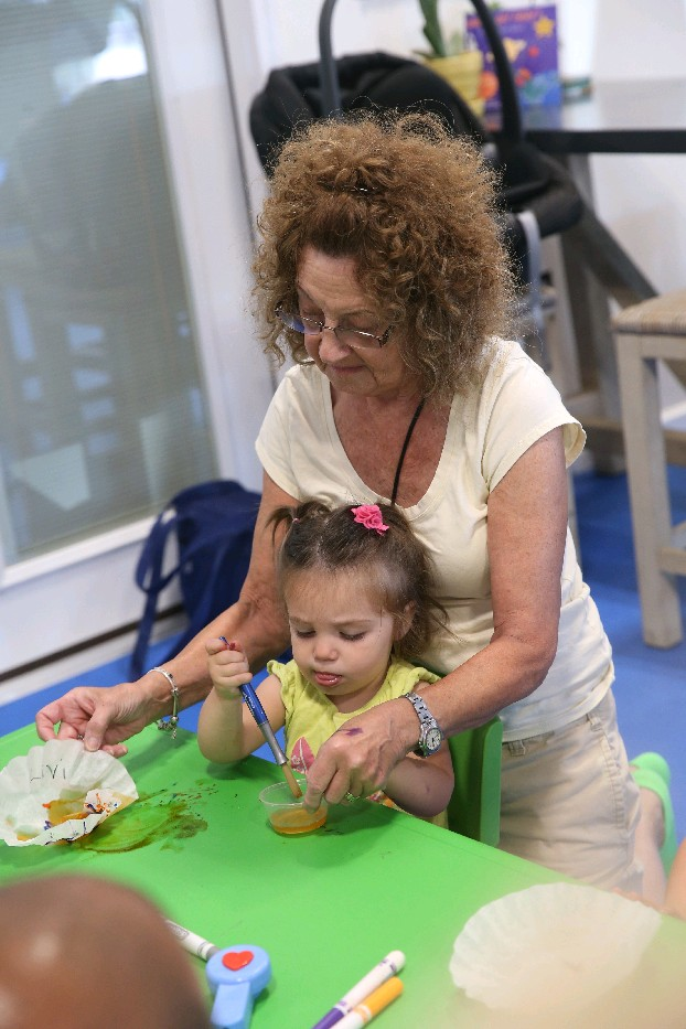 "Retired pre-K teacher Nita Yusick, of Lakeview, helps her granddaughter Livi Dollmann, 18 months. ""We've been coming here for more than six months and she's become more social, braver. Everytime we come, she's on a new piece of equipment. She's not inhibited with the crowd anymore. She has some friends who've become consistent in the class. There have been special kids who have been here and that's a good exposure for everybody."""