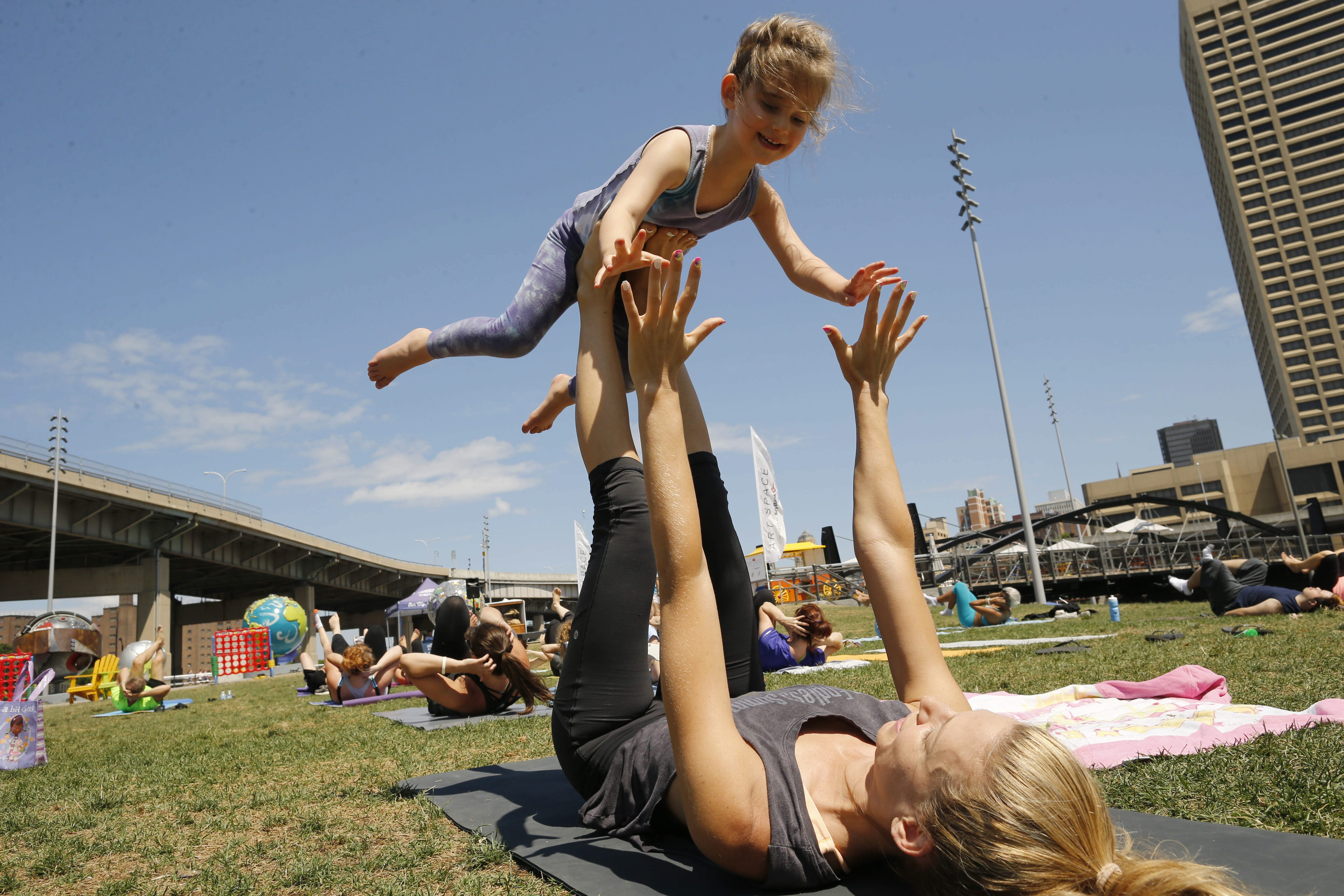 'The streak' of temperatures in the 70s  or higher in Buffalo was in its early weeks when this yoga class was held at Canalside on July 5.  (Derek Gee/Buffalo News)
