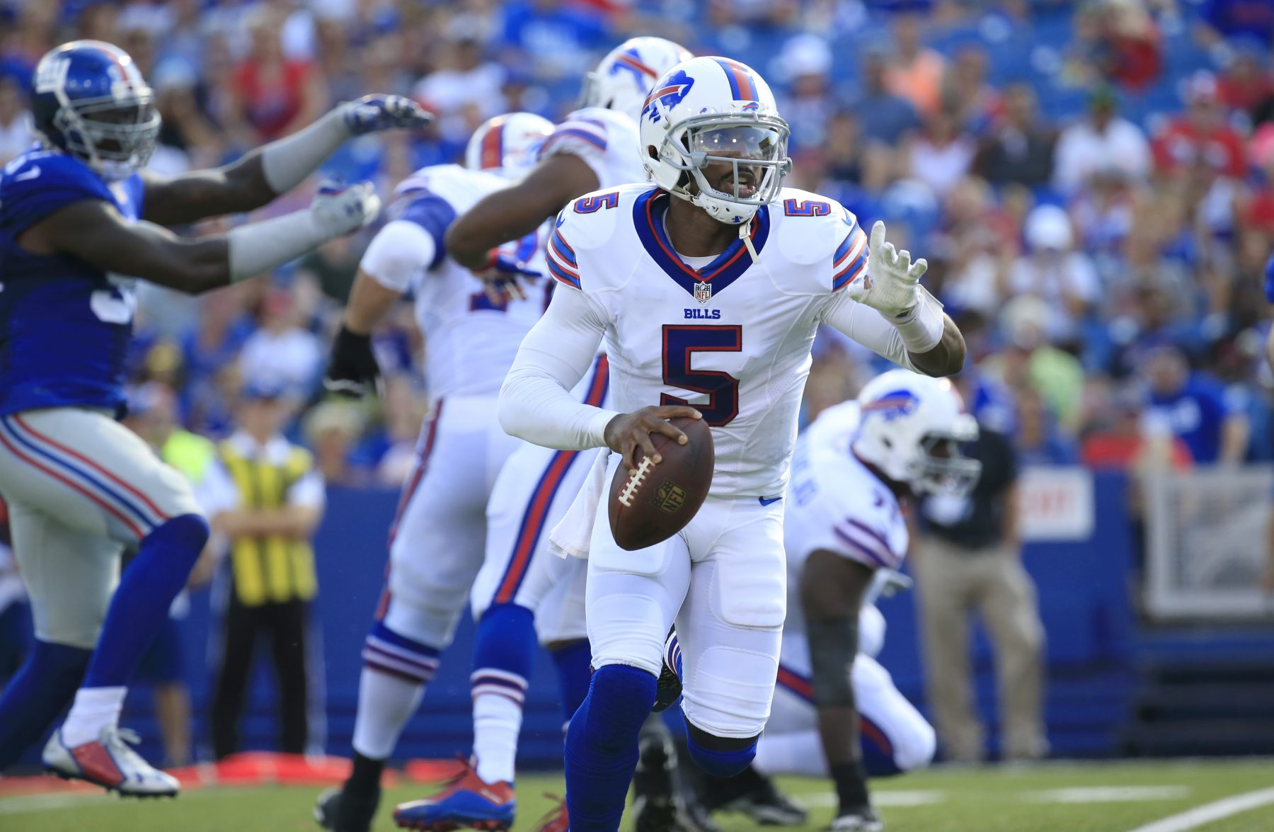 Buffalo Bills Tyrod Taylor runs against the New York Giants during first quarter action at New Era Field on Aug. 20. (Harry Scull Jr./Buffalo News)