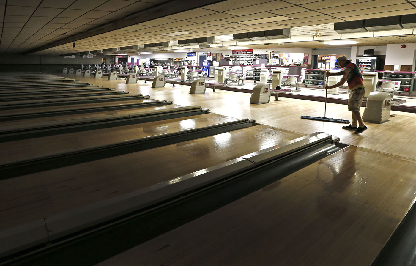 Jamie Ross sweeps on Monday, Aug. 8, 2016. Voelker's Lanes, which has been an entertainment hotbed in Buffalo since 1892. The Elmwood Avenue landmark is known for its colorful, flashing neon sign, vintage barroom and the sights and sounds of bowling. (Robert Kirkham/Buffalo News)