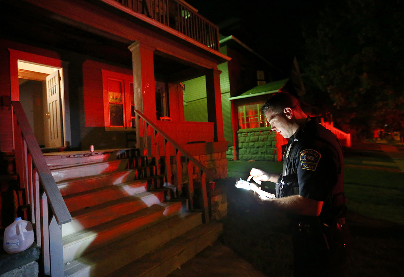 UB students have returned to Buffalo for school starting on Monday. They flood the University Heights neighborhood for partying, Saturday, Aug. 27, 2016. Buffalo Police Officer Patrick McDonald writes up a citation for the residents of 72 Winspear after the police broke up a party there. (Sharon Cantillon/Buffalo News)
