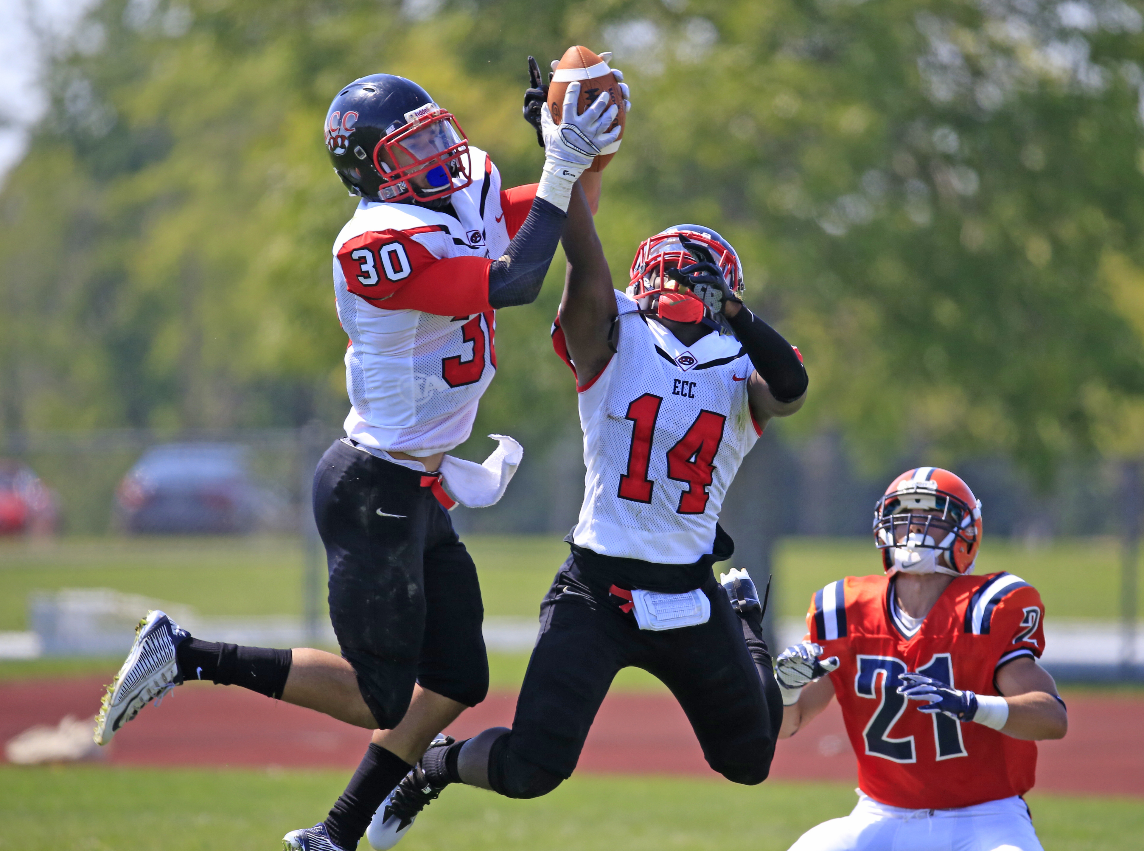 Erie Community College's Justin Jones intercepts a Nassau County Community College Lions pass during first half action of ECC's season opener. (Harry Scull Jr./Buffalo News)
