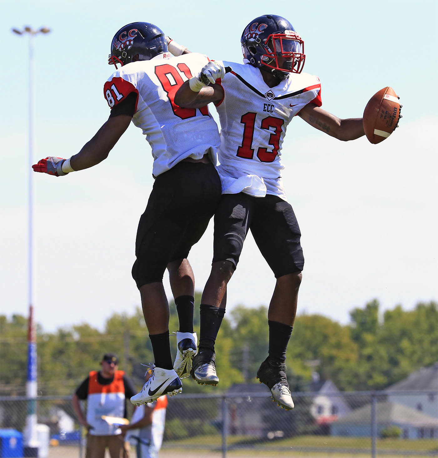 Erie Community College's jametrius Lewis celebrates his touchdown with Montier jackson during foruth quarter action against Nassau County Community College Lions at the ECC South campus on Saturday, Aug. 27, 2016. (Harry Scull Jr./Buffalo News)