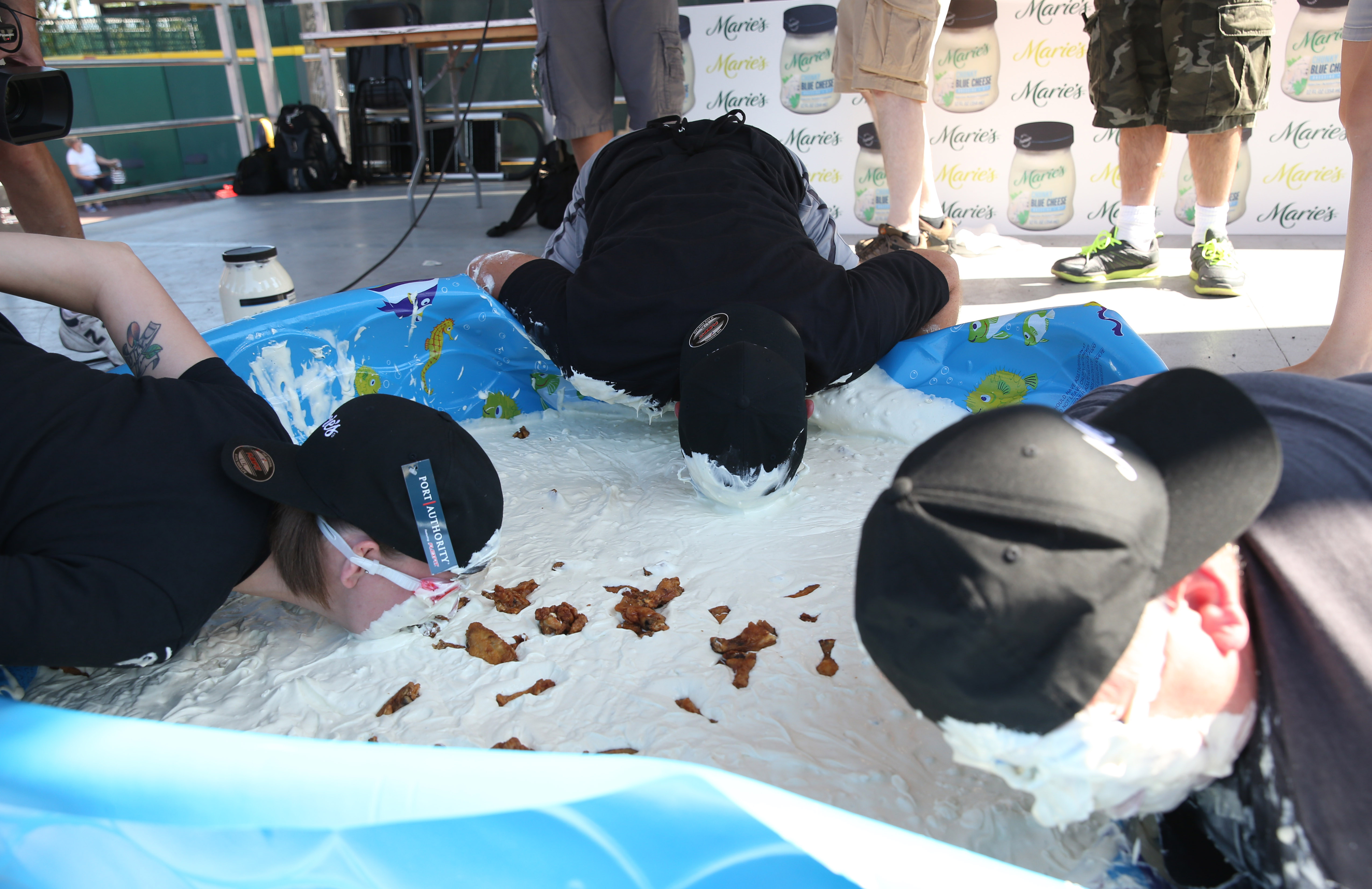 The 15th Annual National Buffalo Wing Festival kicks off, Saturday, Sept. 3, 2016. Three contestants participate in the bobbing for wings contest. With goggles on they pull wings pulled out of a kids pool filled with blue cheese dressing. (Sharon Cantillon/Buffalo News)