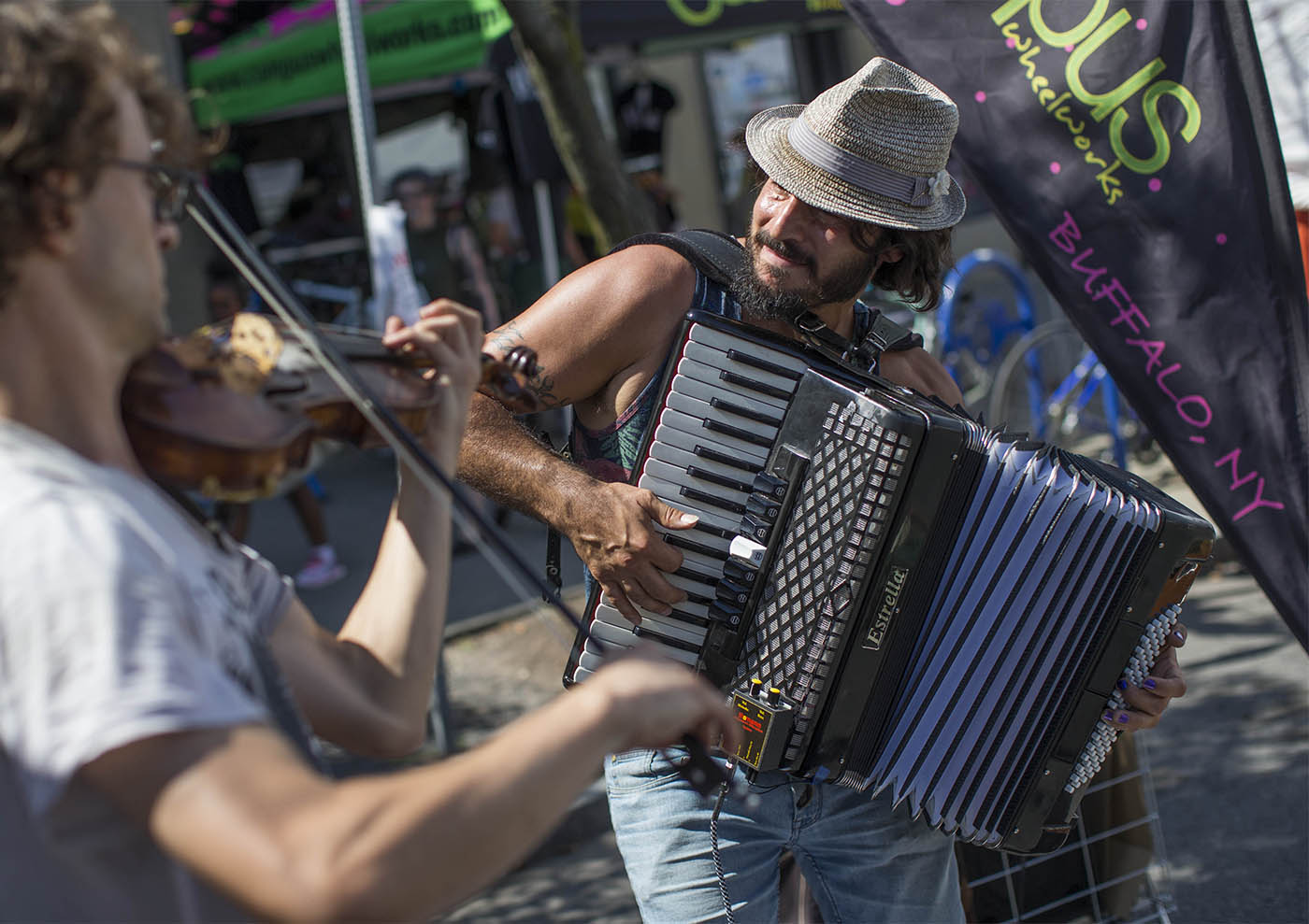 David Adamczyk and Christopher Kozlowski perform on the street at the Elmwood Avenue Festival for the Arts, Saturday, Aug. 27, 2016. (Derek Gee/Buffalo News)