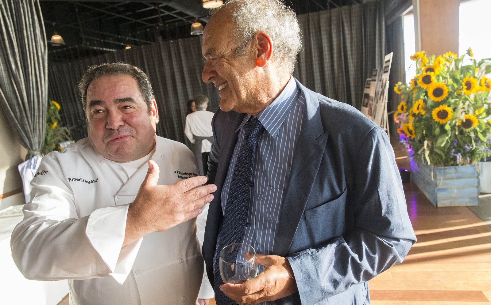 Legendary producer Shep Gordon, right, chats with celebrity chef Emeril Lagasse during a fundraiser. (Derek Gee/Buffalo News)