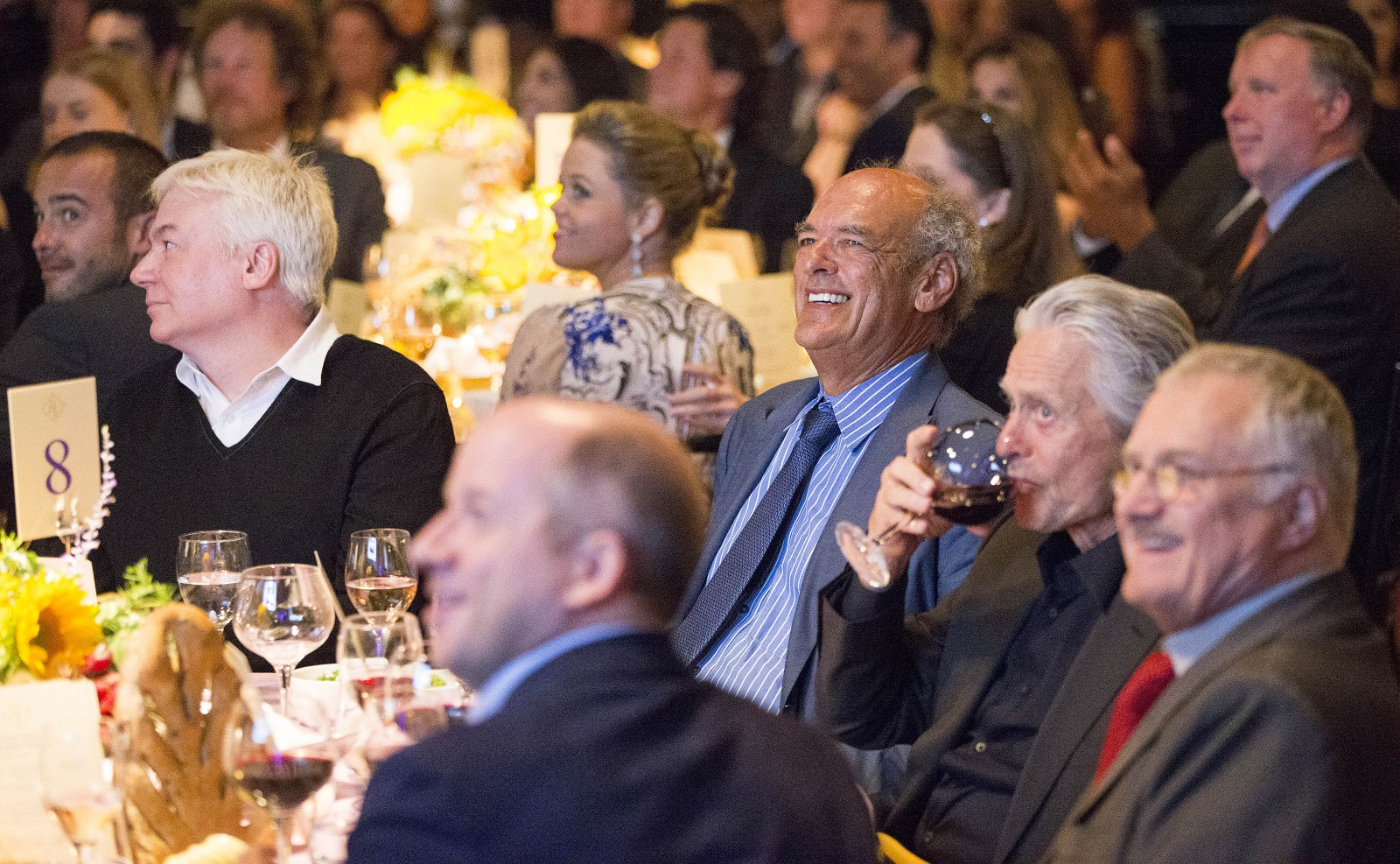 Legendary producer Shep Gordon, center, sits with actors Mike Myers, left, and Michael Douglas, right, during a fundraiser he co-hosted to start a scholarship to the Culinary Institute of America in honor of his late friend, legendary chef Roger Verge, at the Lighthouse at Chelsea Piers in New York City. (Derek Gee/Buffalo News)