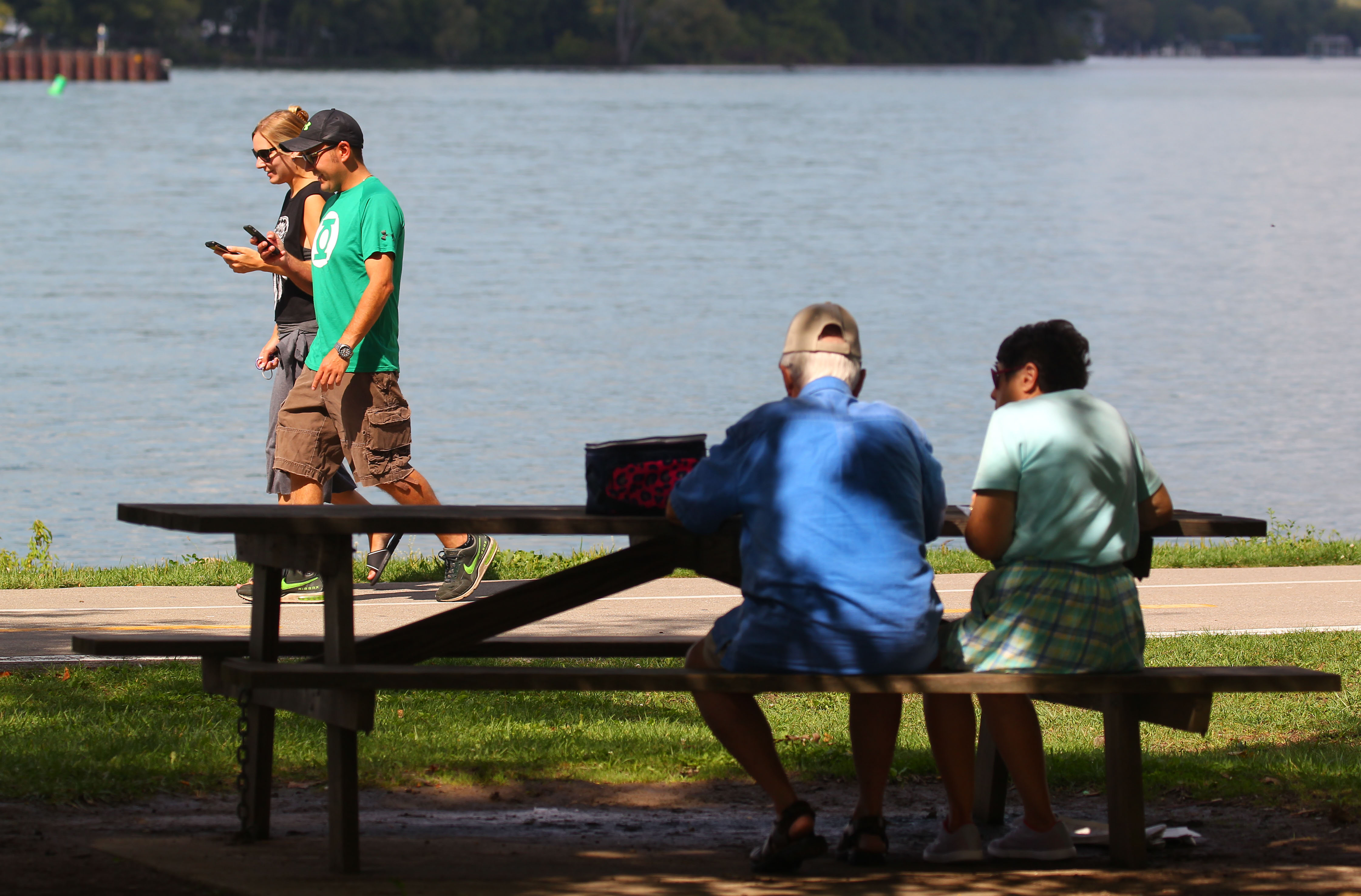 People enjoy lunch and a walk through Niawanda park in Tonawanda on another 80-degree day in September.  (Mark Mulville/Buffalo News)