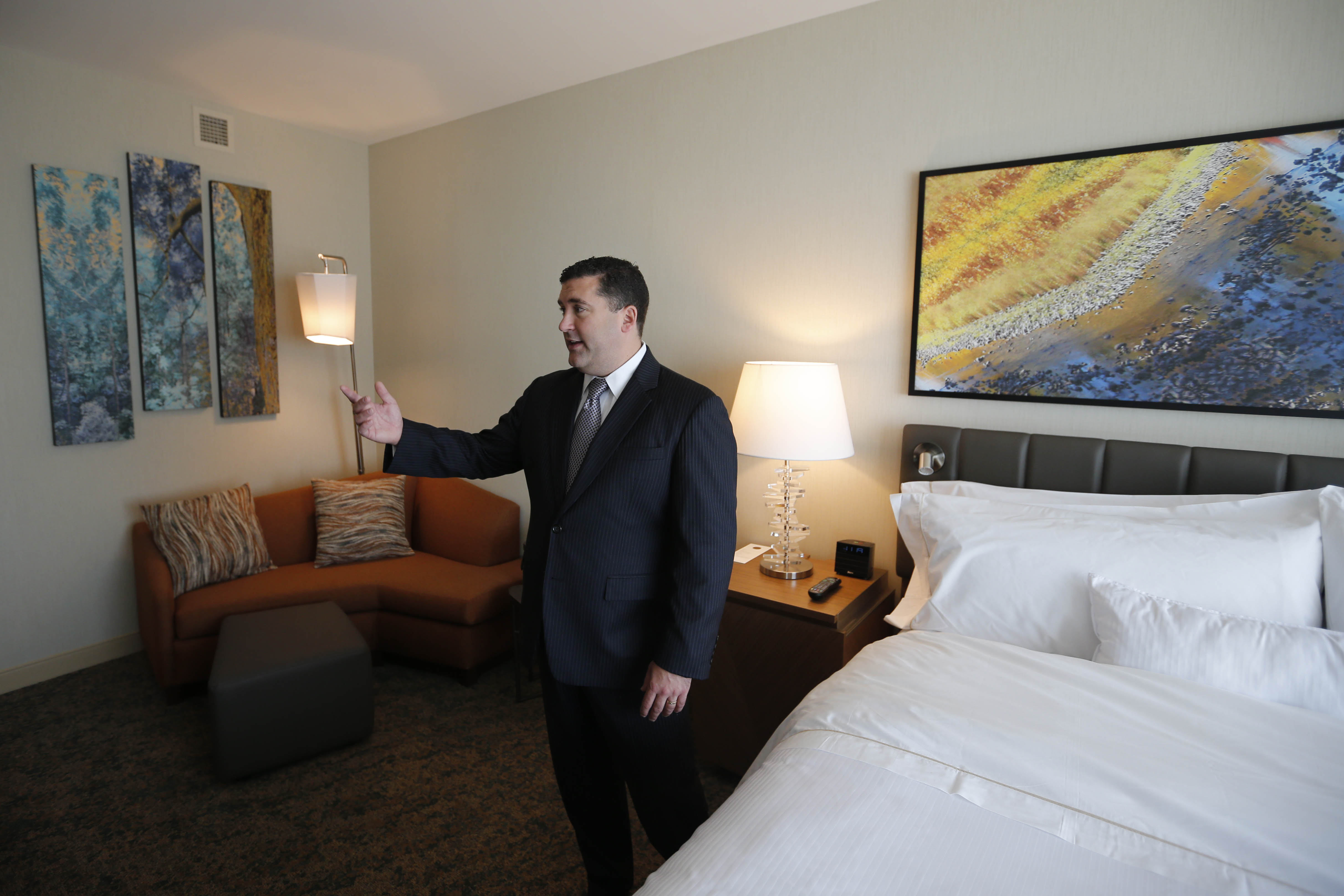 Thomas Long, general manager of the new Westin Hotel, shows off a guest room during a tour. Long, a South Buffalo native, was a top manager at the Waldorf before he quit earlier this year to come home and run the Westin for Delaware North. (Derek Gee/Buffalo News)