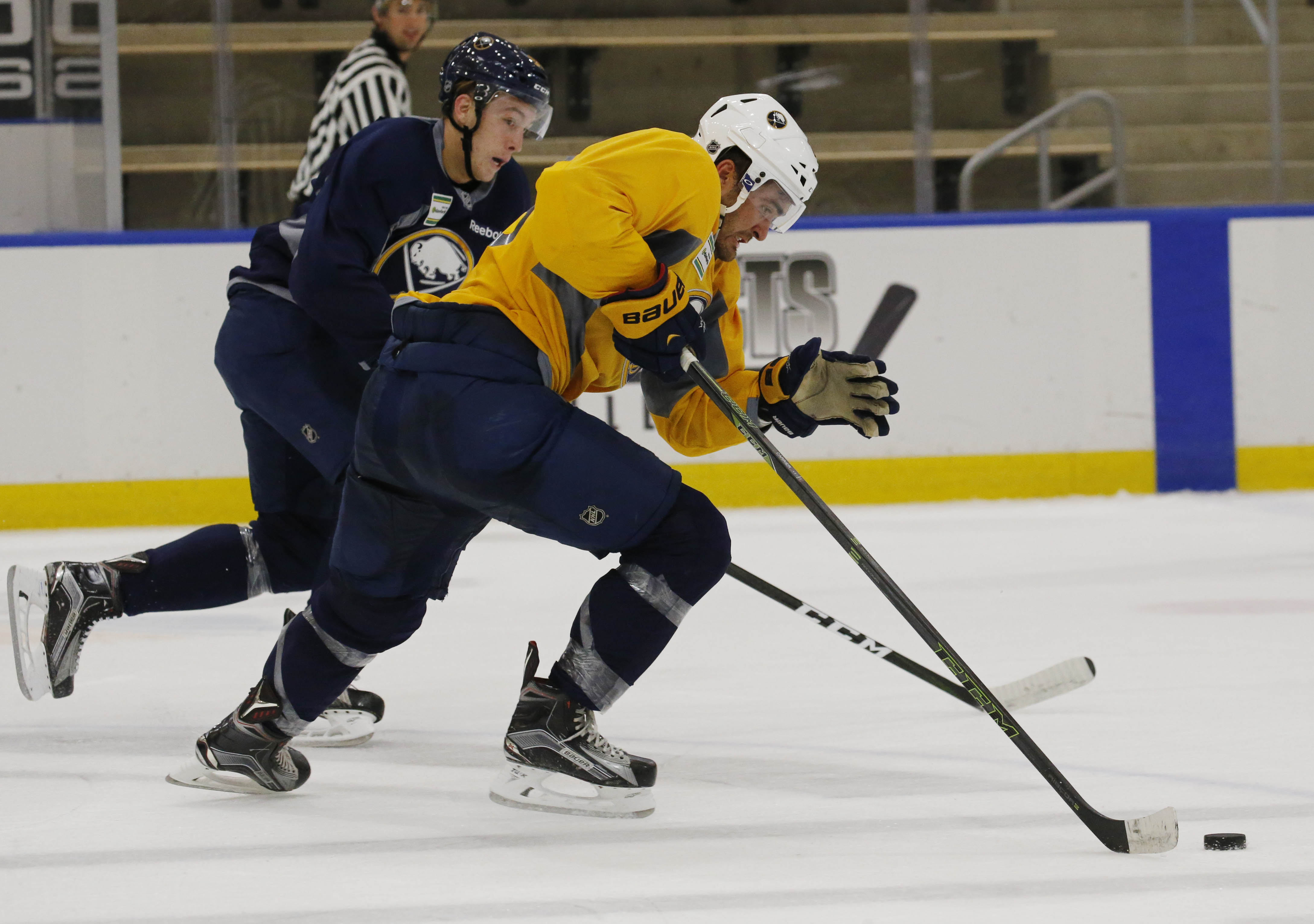 Austin Osmanski (blue) was one of the Sabres' six cuts Monday. William Carrier, gold, is still with the team.  (Derek Gee/Buffalo News)