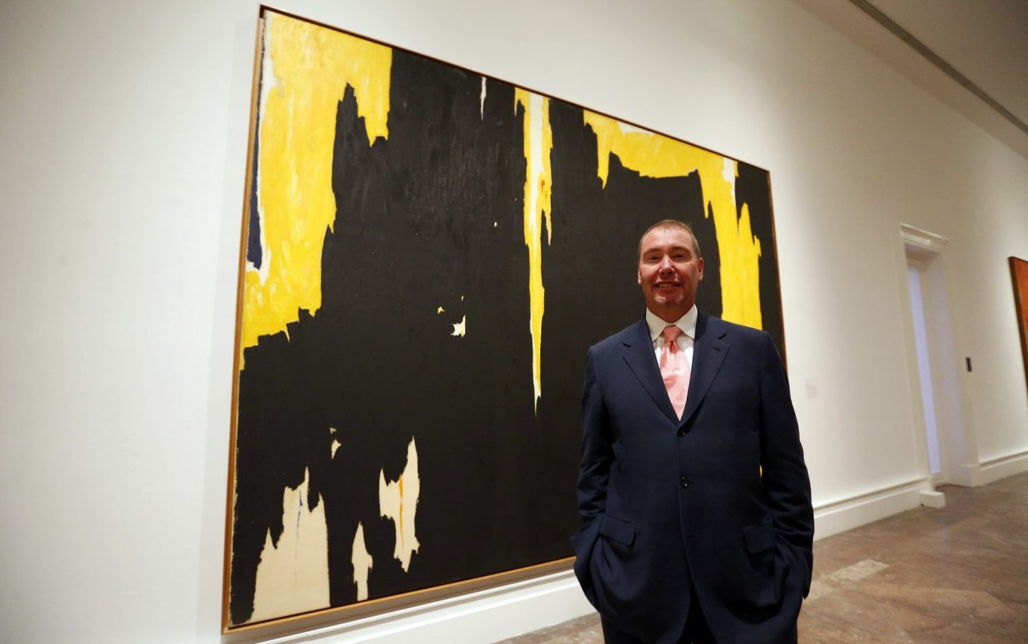 Jeffery Gundlach stands in front of Clyfford Stills painting 1957-D No. 1 in the Albright Knox Art Gallery. (Mark Mulville/Buffalo News)