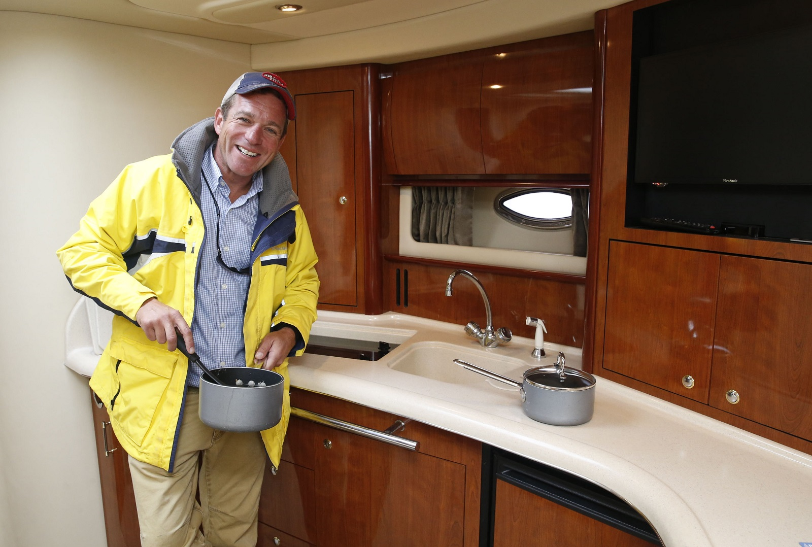 Curtin hangs out in the yacht's kitchen. (Robert Kirkham/Buffalo News)