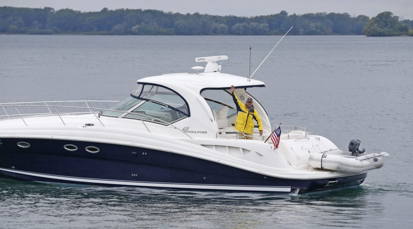 Table for six? Restaurateur Tucker Curtin in his new 45-foot Chris Craft Sundancer which he will be outfitting as a a floating restaurant boat. (Robert Kirkham/Buffalo News)