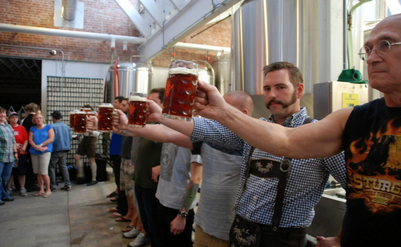 A stein-hoisting competition will be held at the  Resurgence Oktoberfest party. (Courtesy Resurgence)